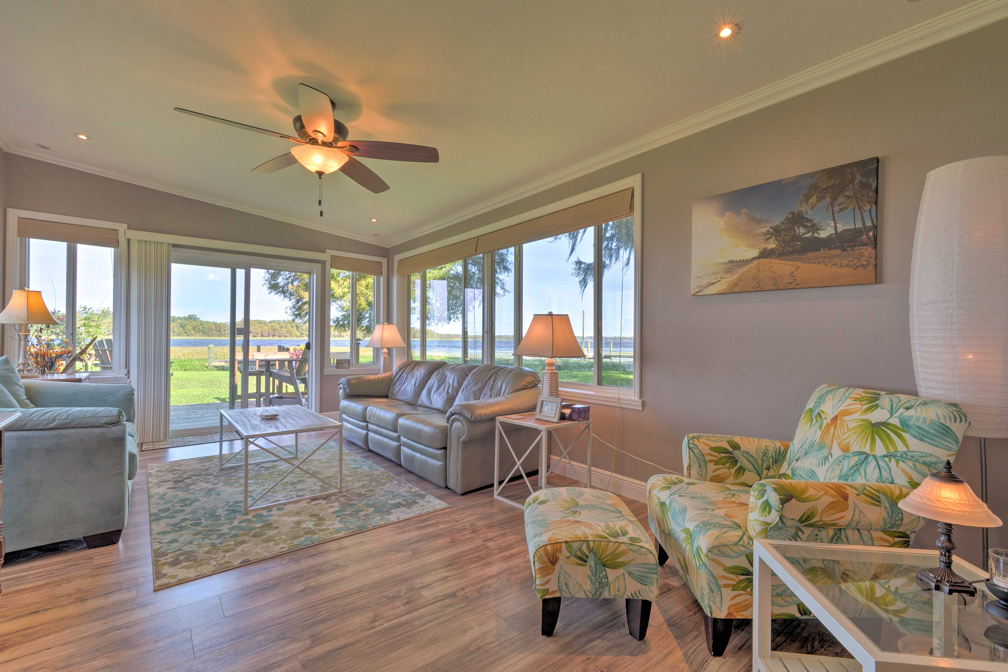 The bungalow home features comfortable seating and tropical decor.