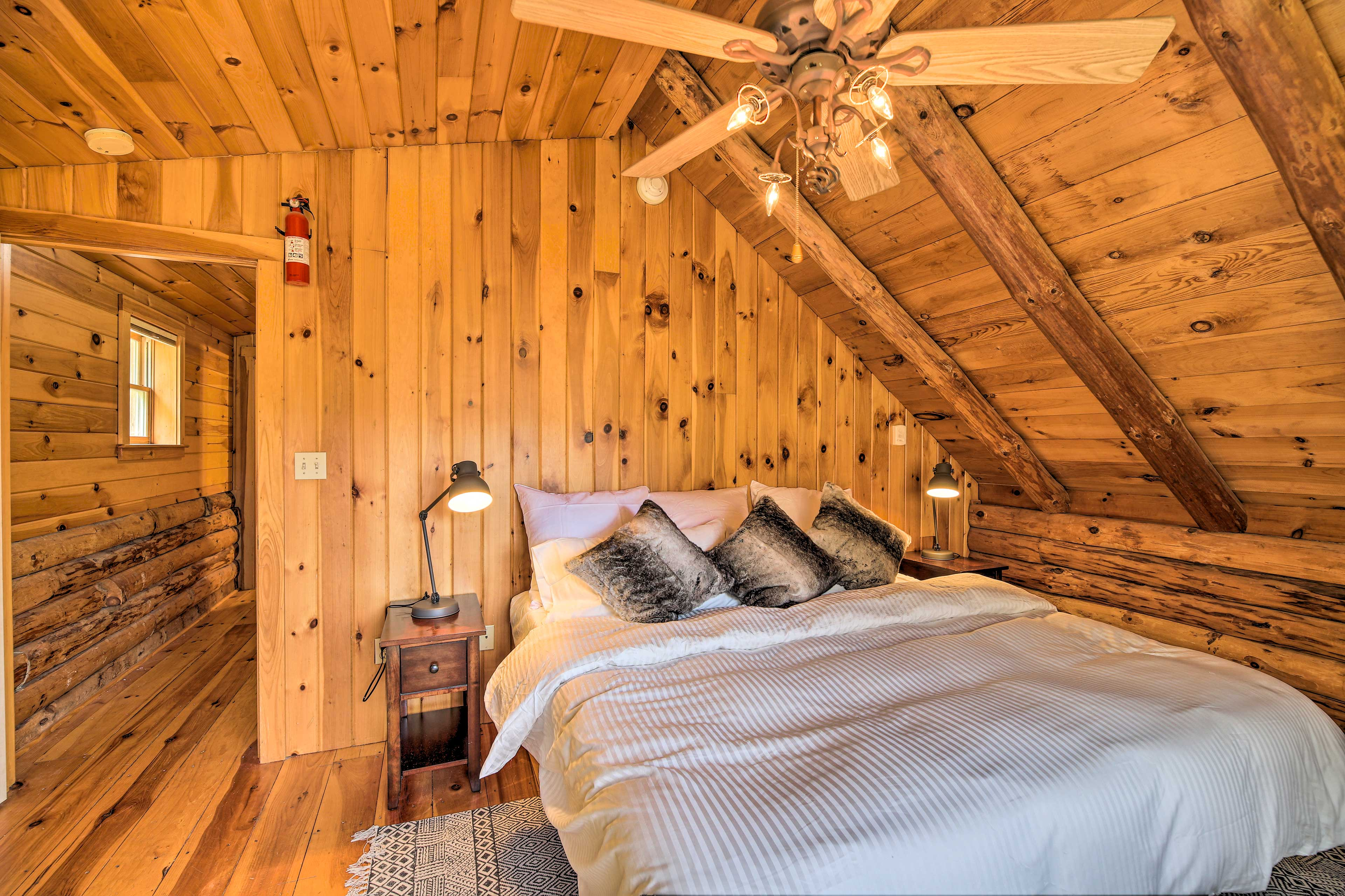 This bedroom is outfitted with a king bed as well.