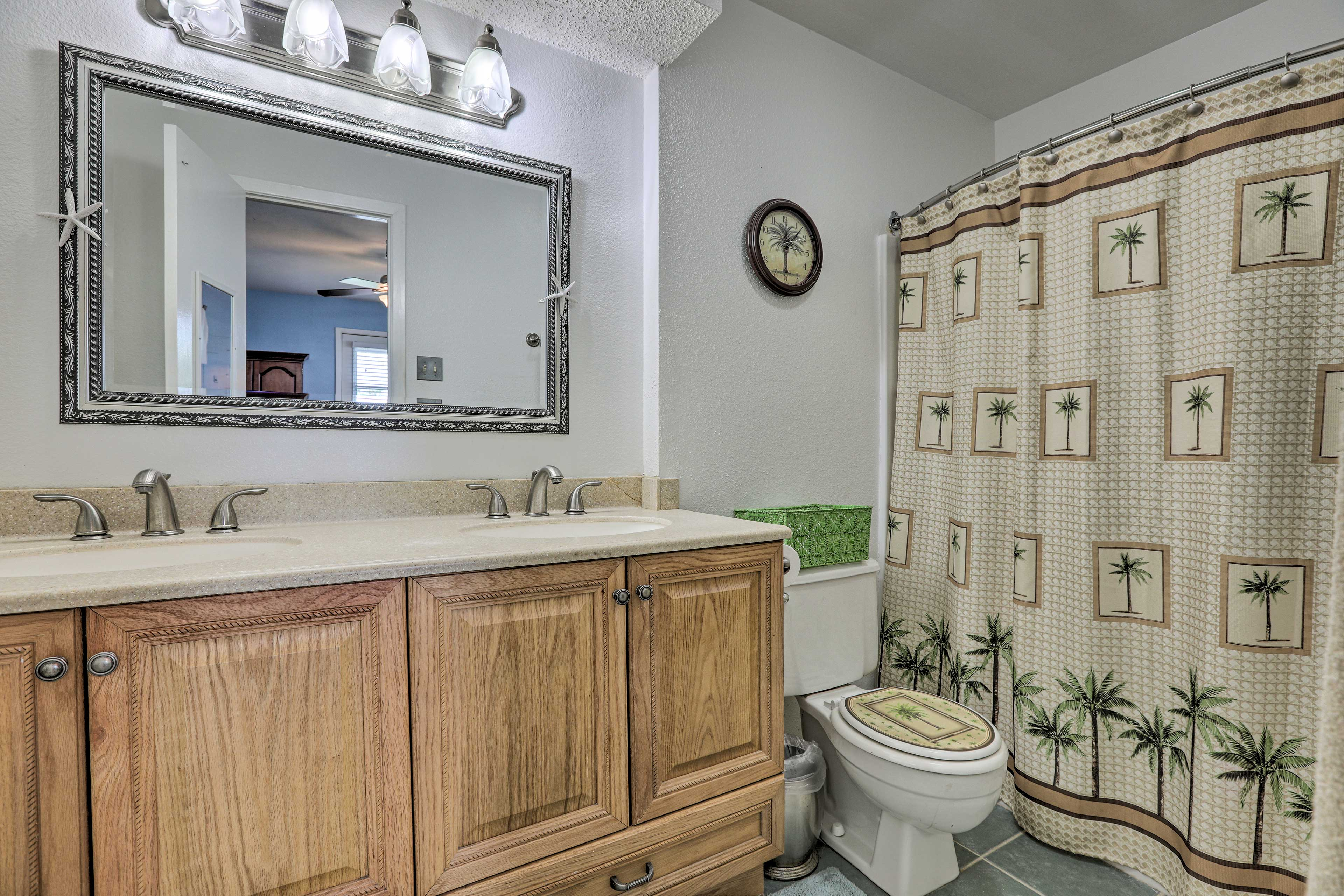 The full bathroom features 2 sinks and a shower/tub combination.
