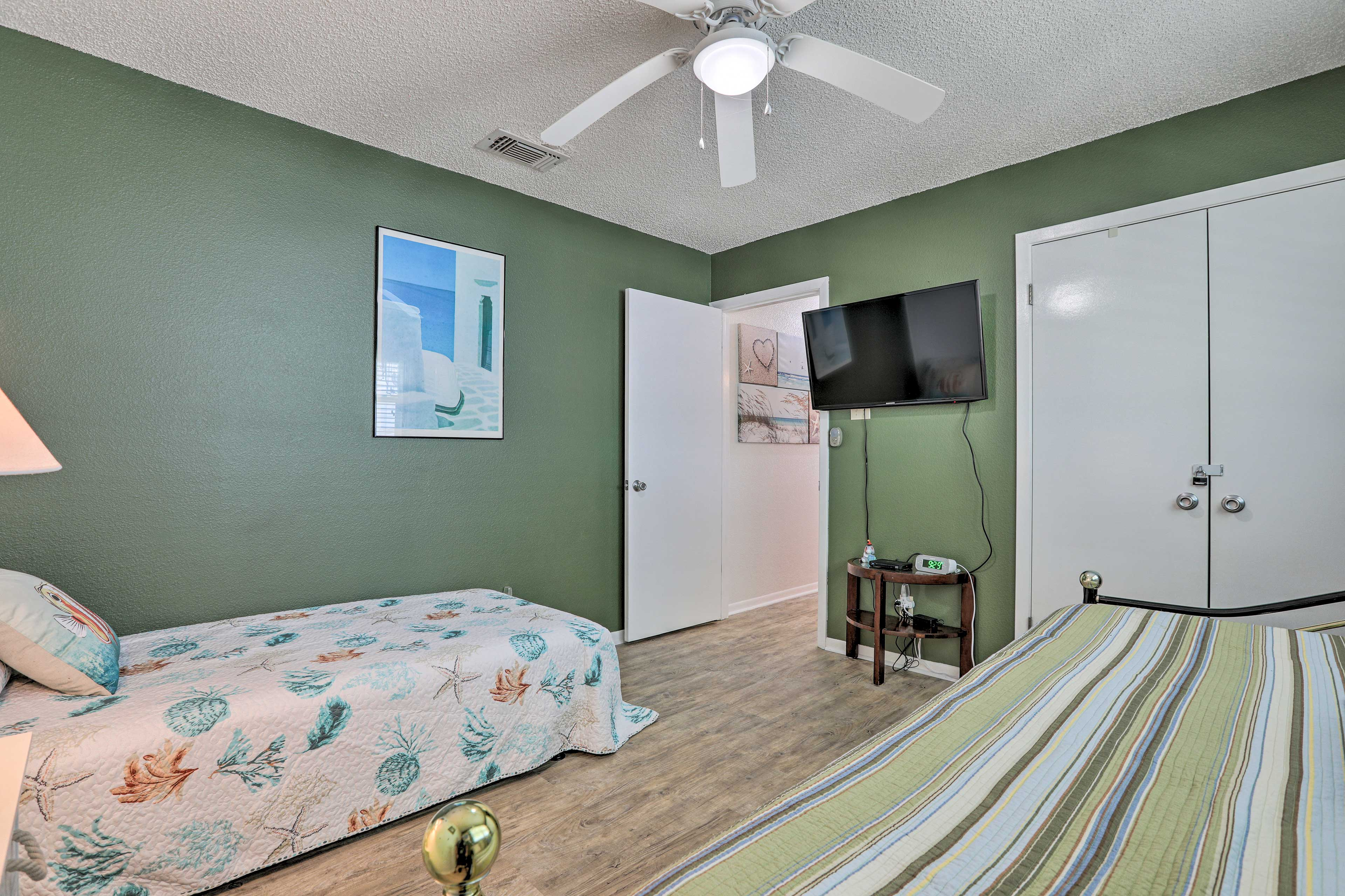 Put the kiddos to bed with a movie on the mounted flat-screen TV!