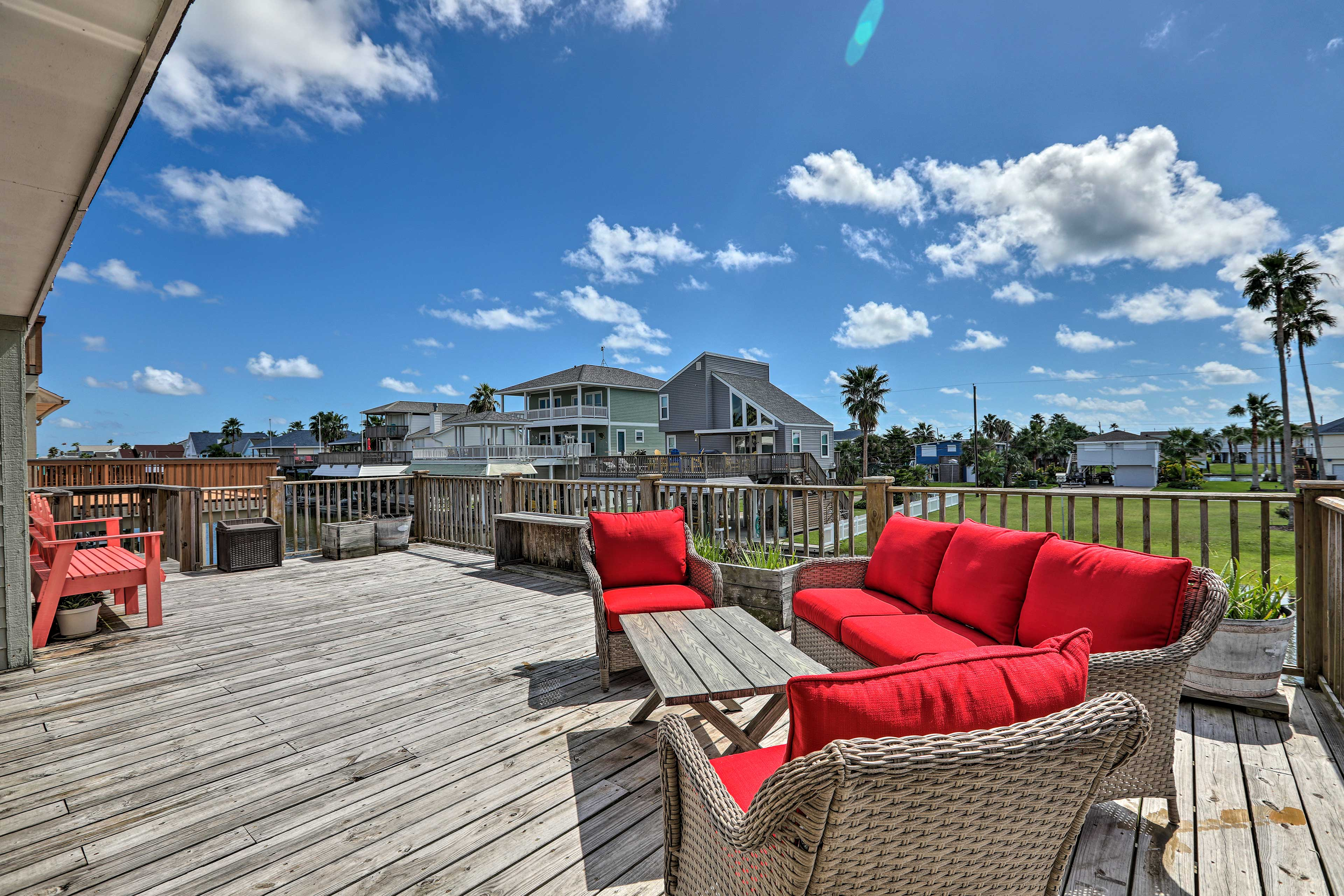 Watch the sunset over the canal from the home's expansive private deck.