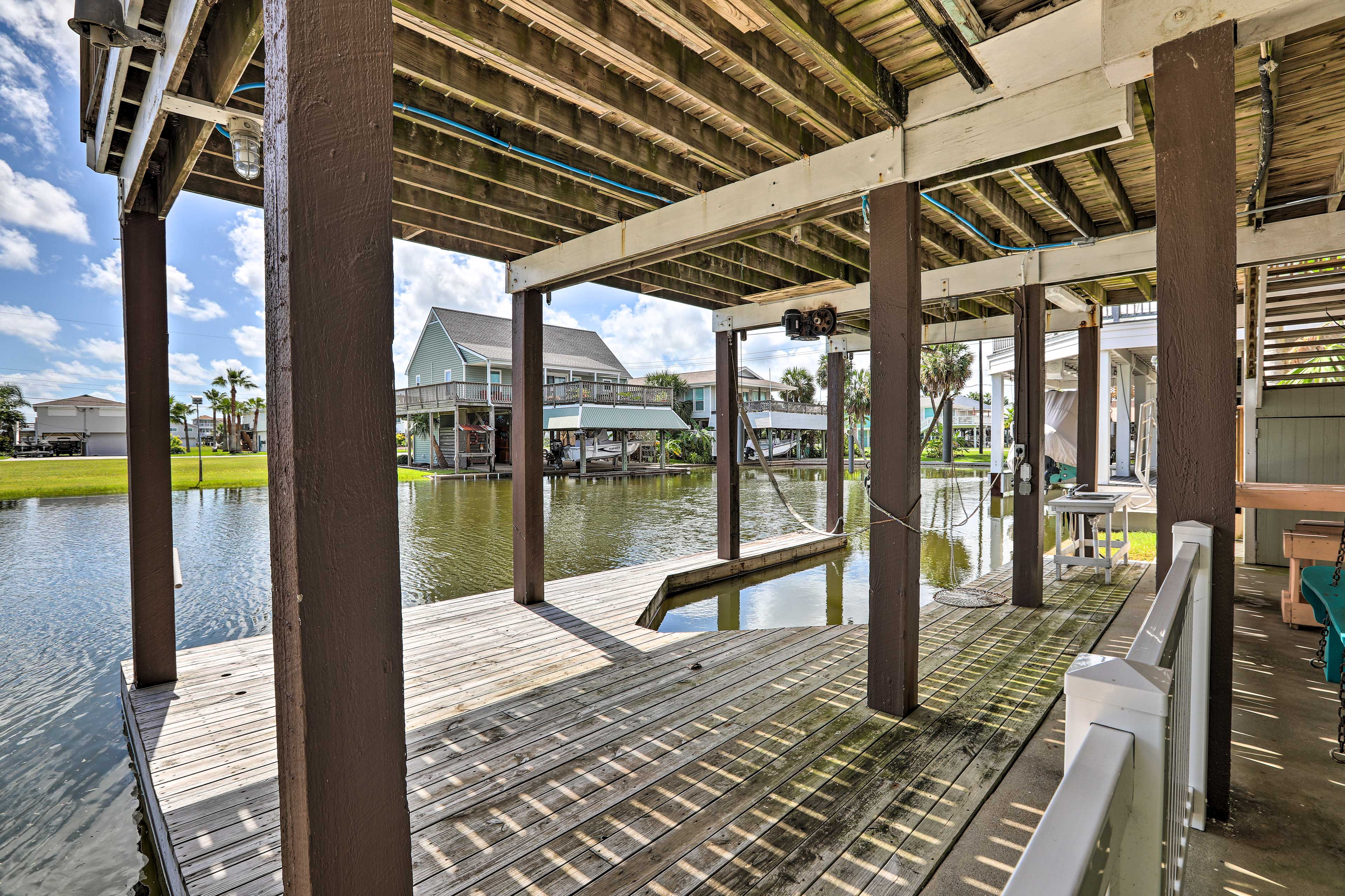 Bring your own boat, as this home offers a boat lift and boat parking.