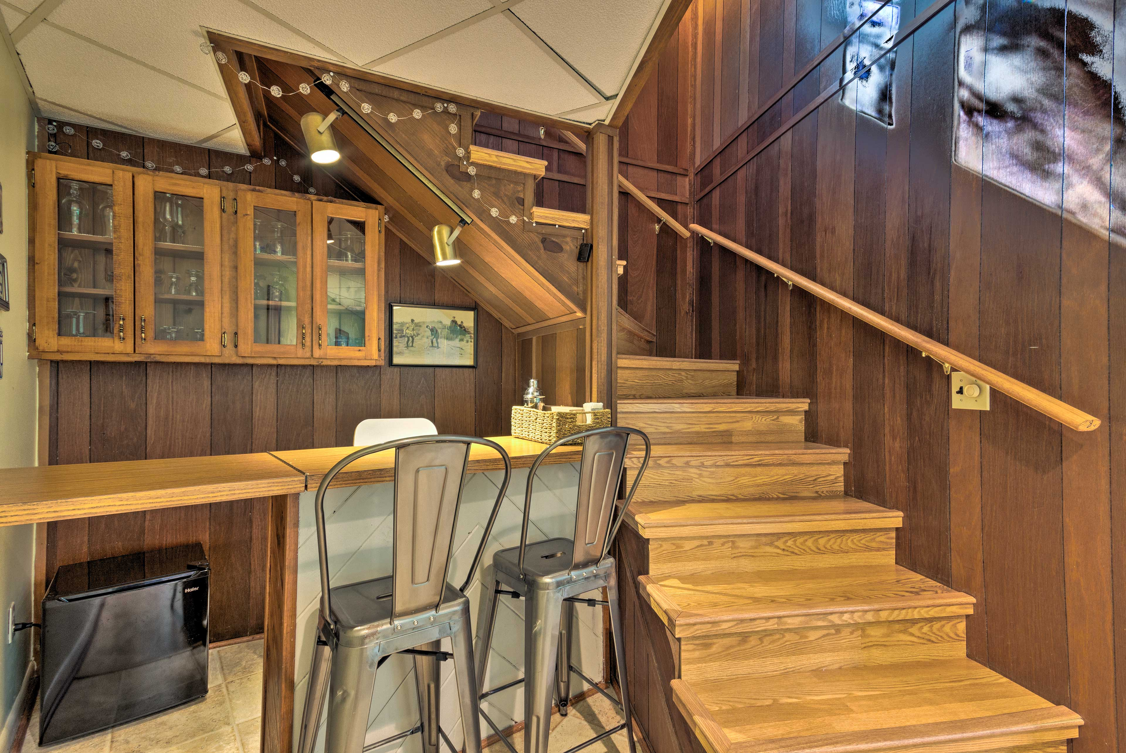 Pour the adult beverages from this bar underneath the staircase.
