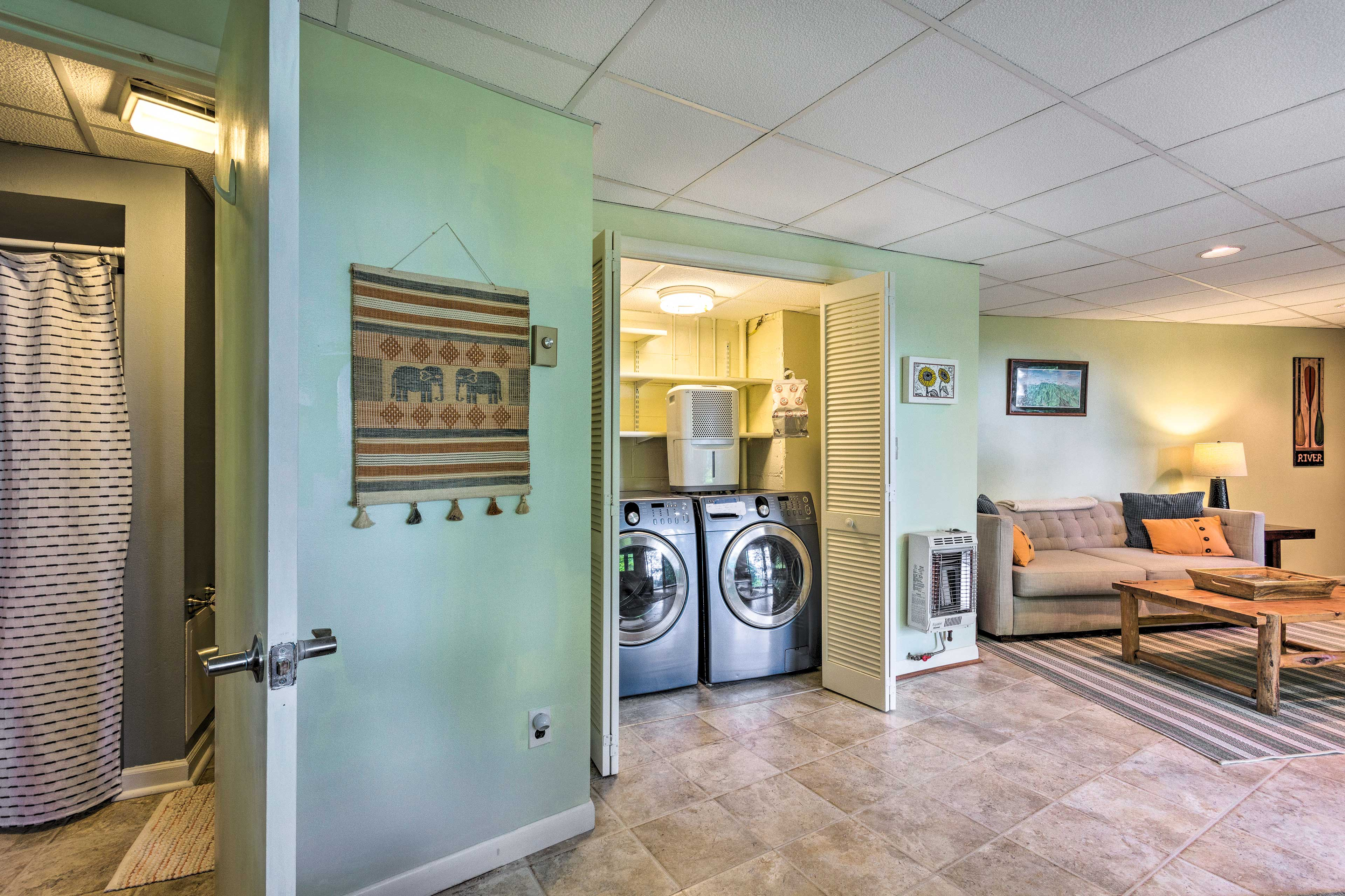 Tucked away, the washer and dryer are available for use.