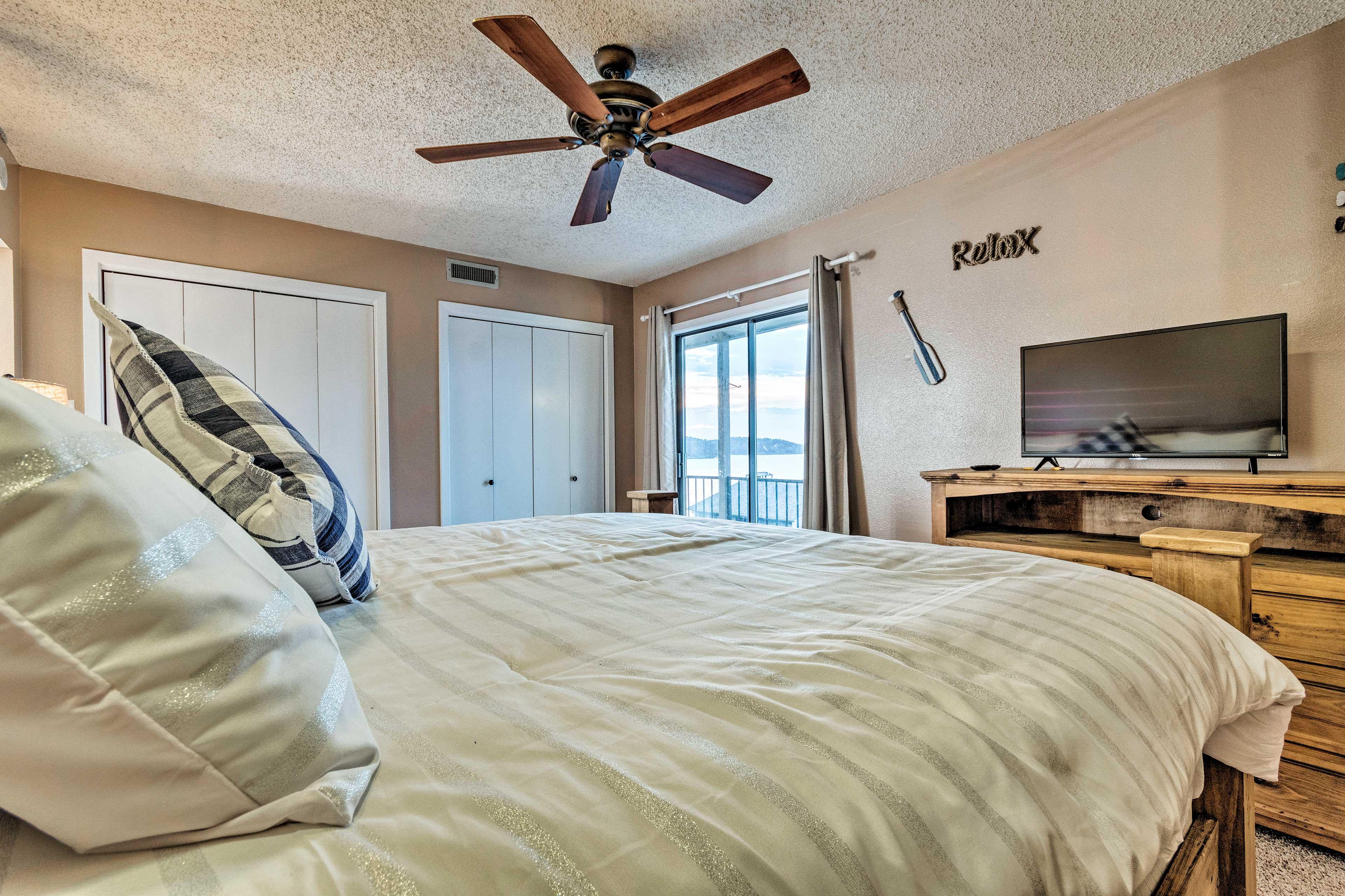 The master bedroom boasts balcony access.