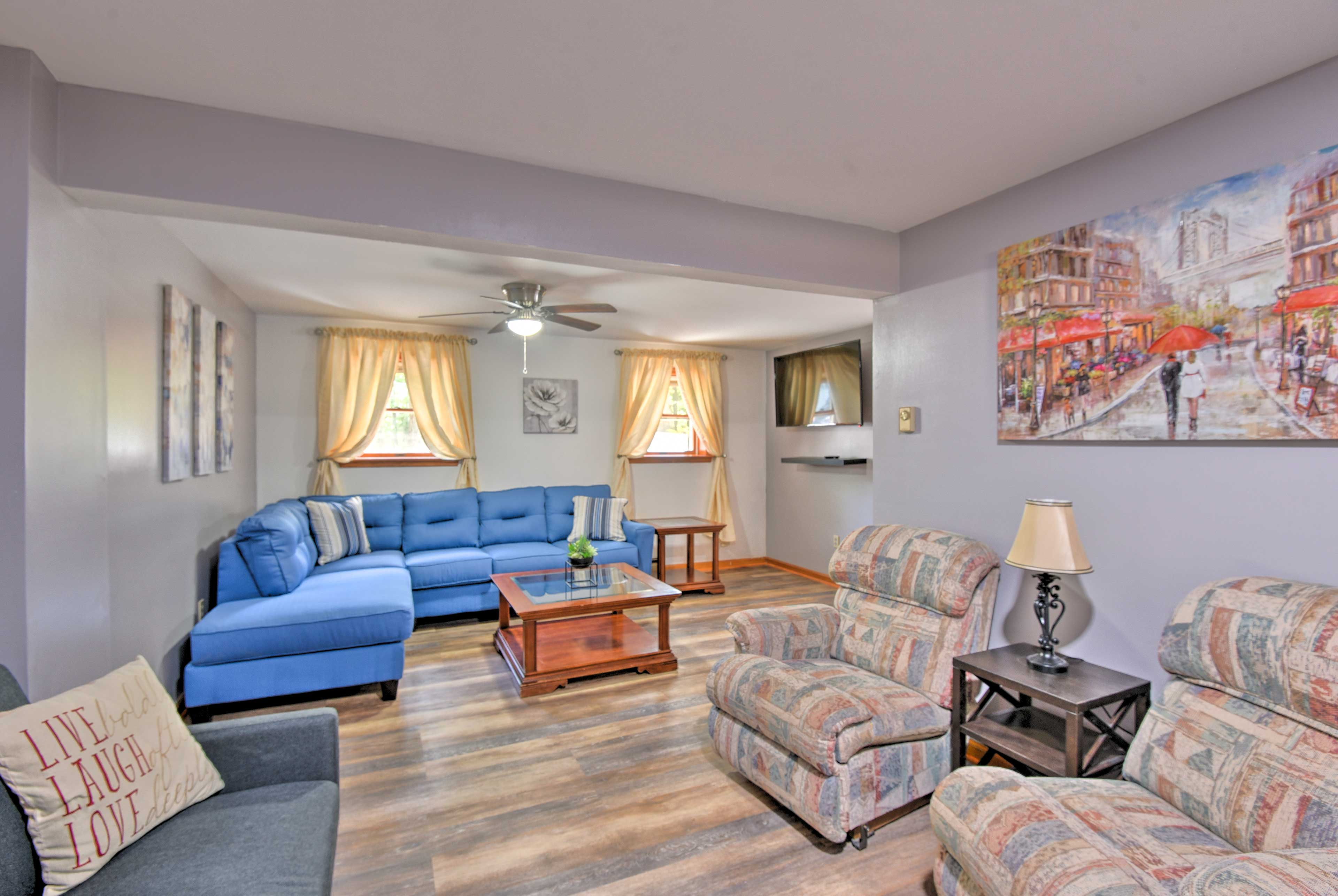 Take a load off in the downstairs living room with plenty of seats for everyone.