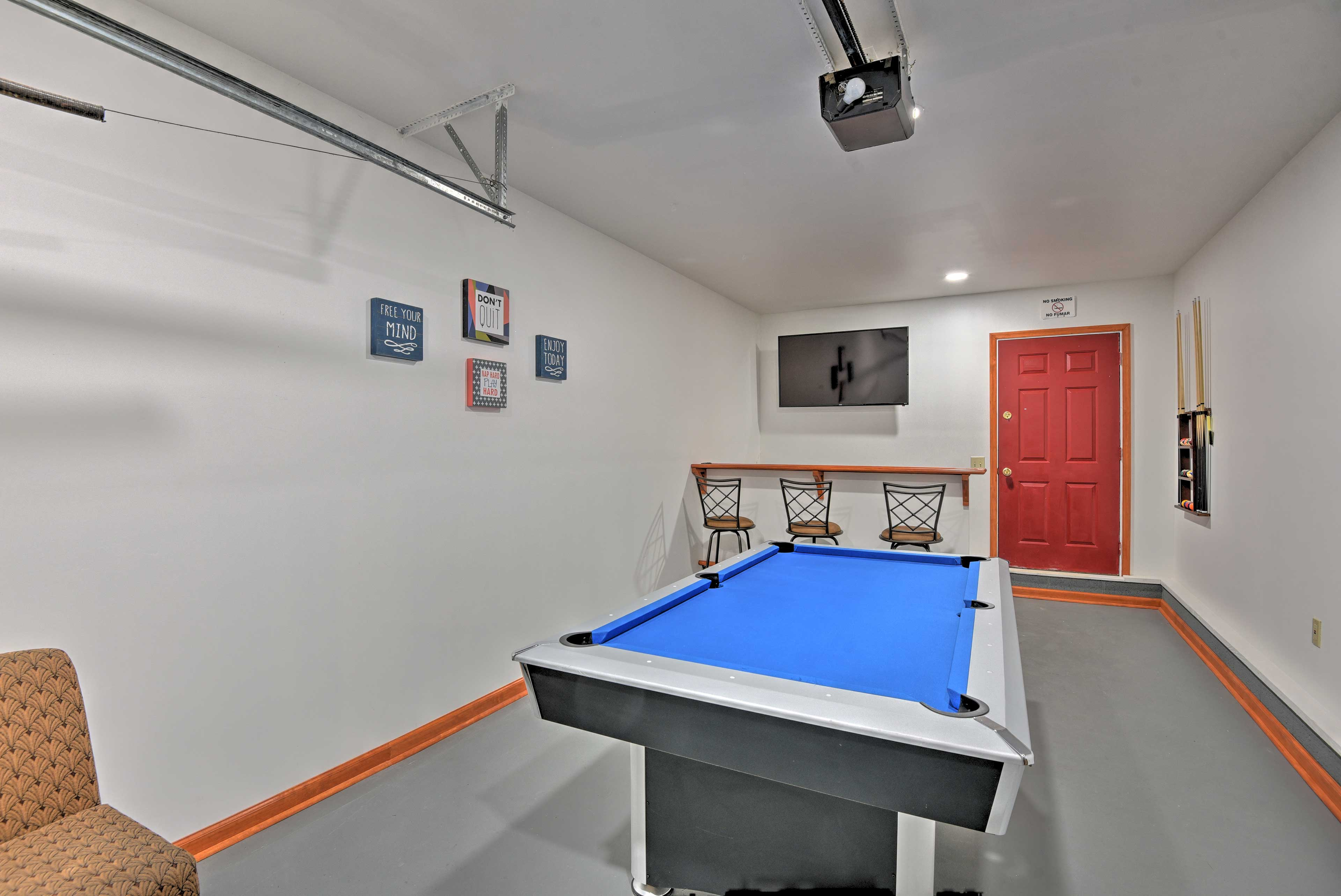 Hang out in the game room, equipped with a pool table and flat-screen TV.