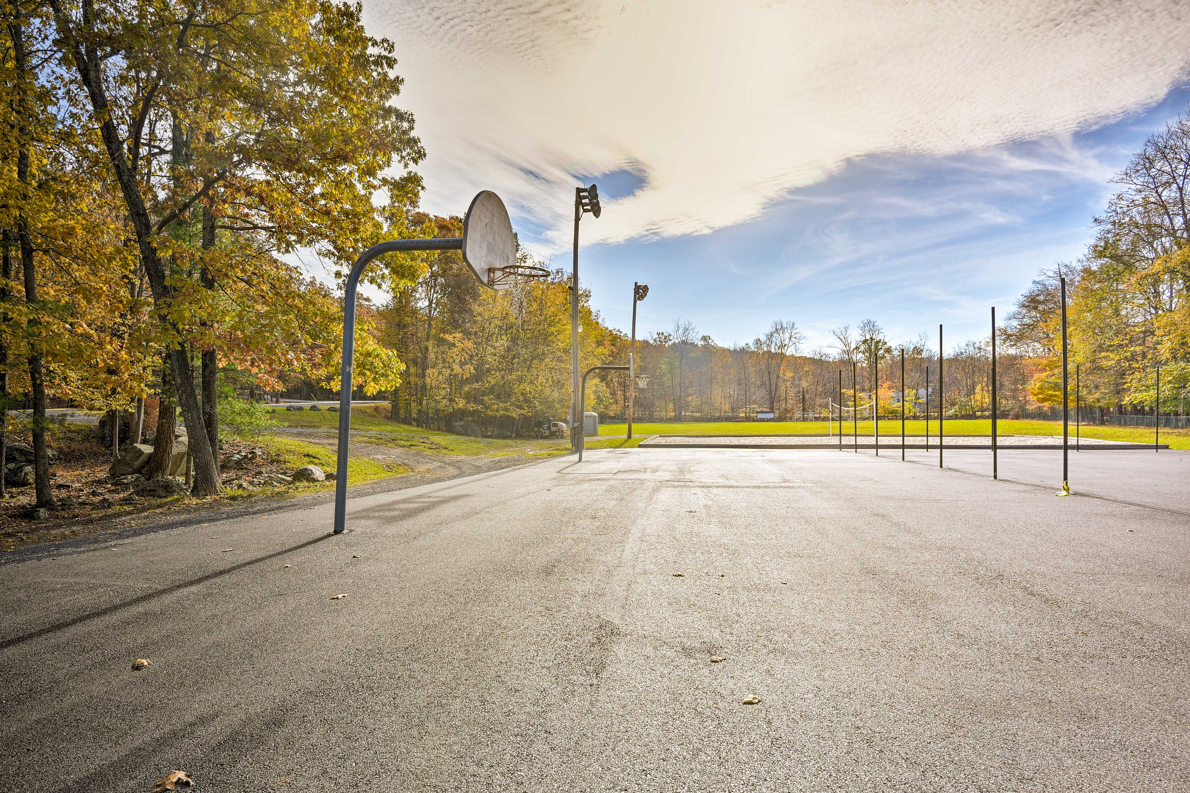 Ball out on the basketball courts near the house.