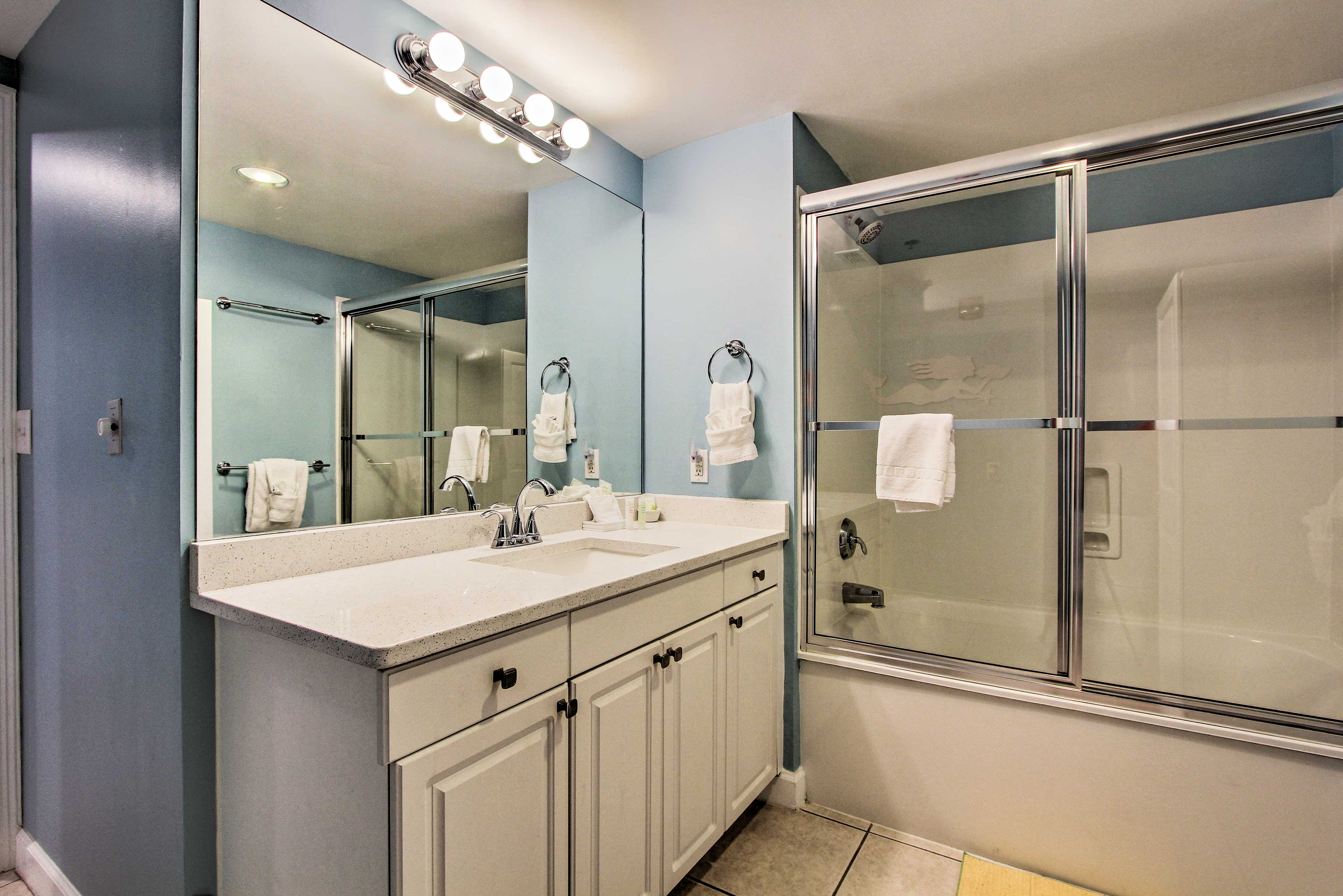 Rinse away the day in this large full bathroom.