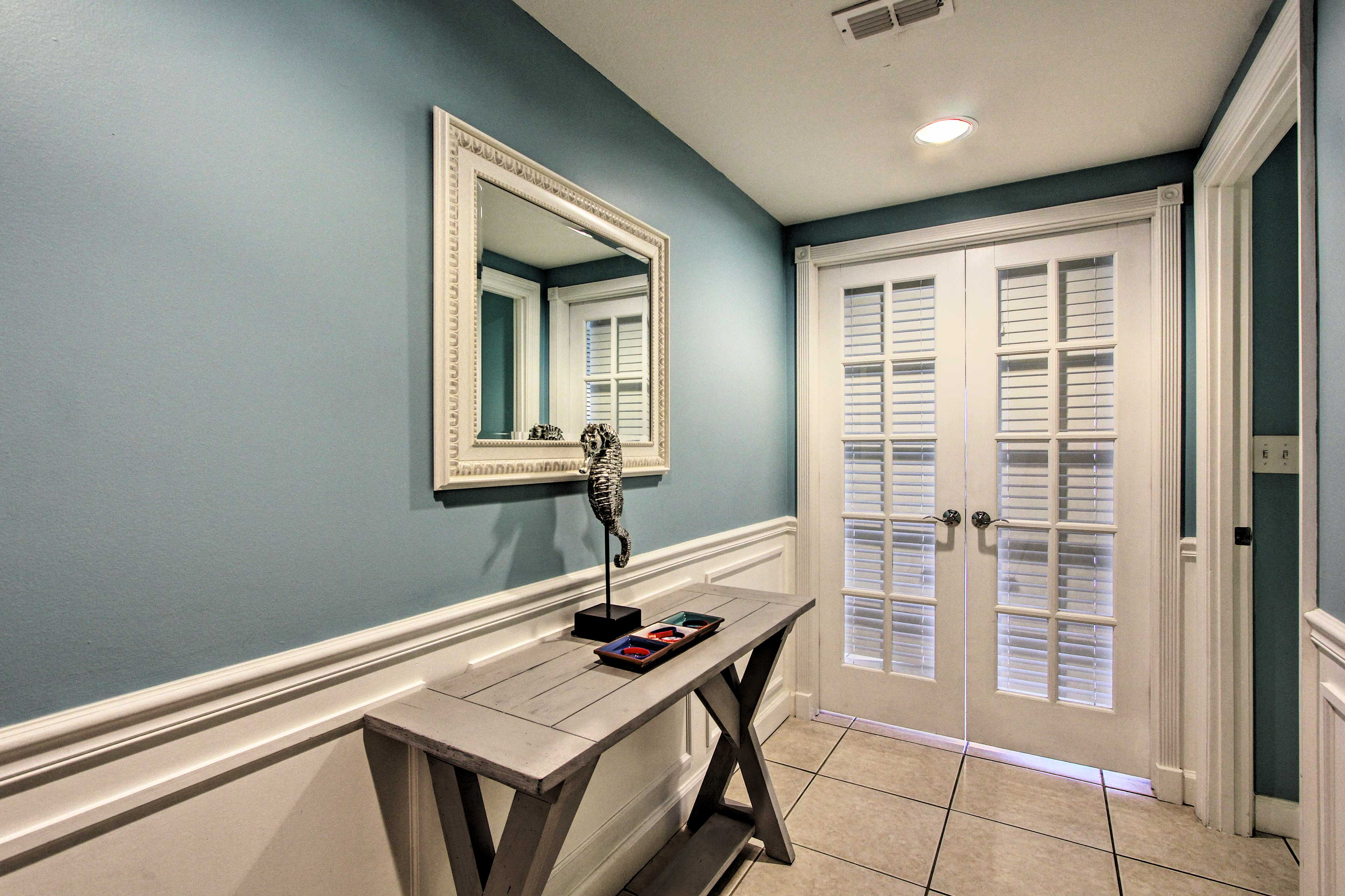 Switch into vacation mode the moment you enter this second-floor condo.