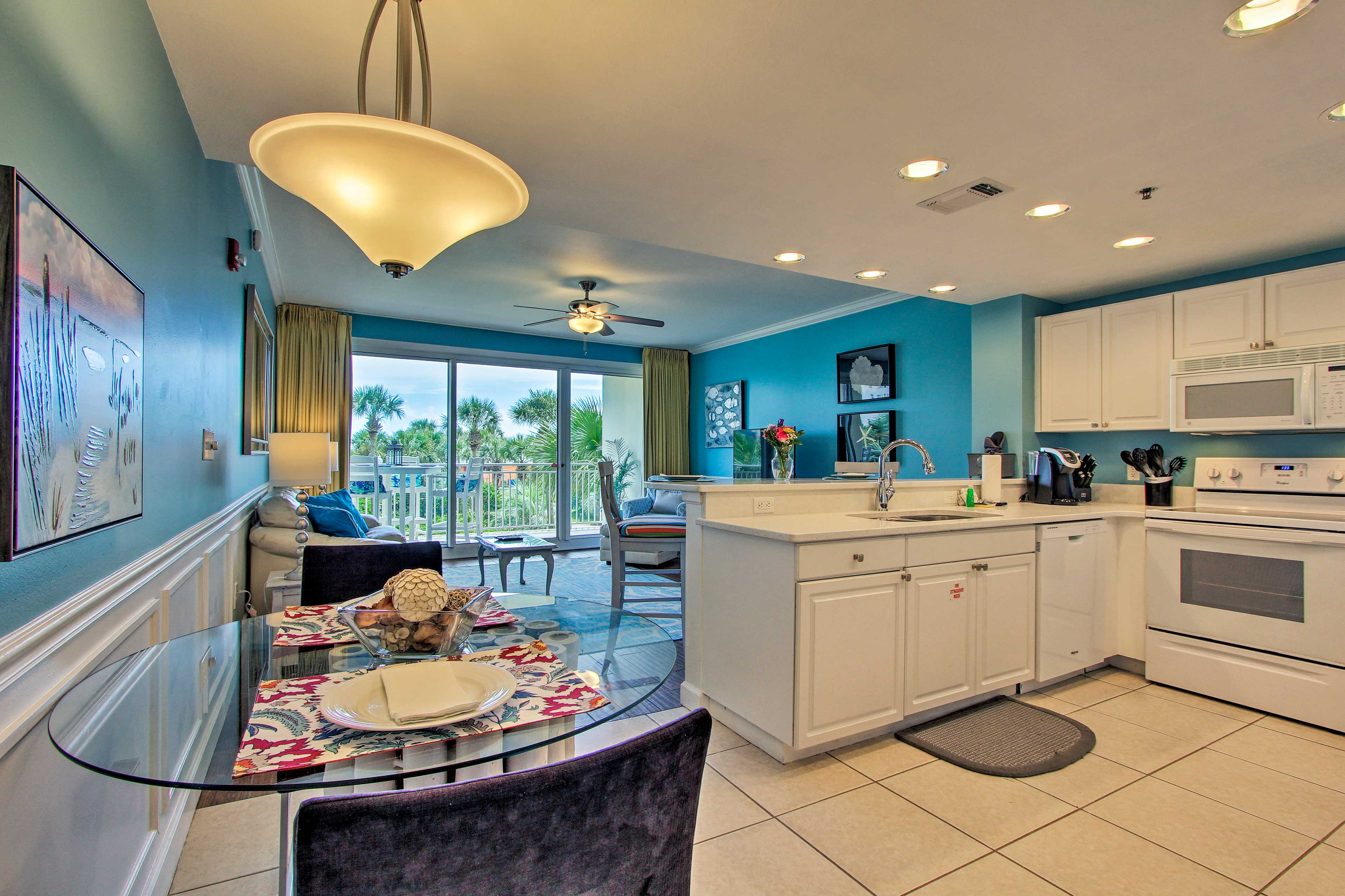 You'll have a full kitchen, breakfast bar, and lush palm tree-filled views!