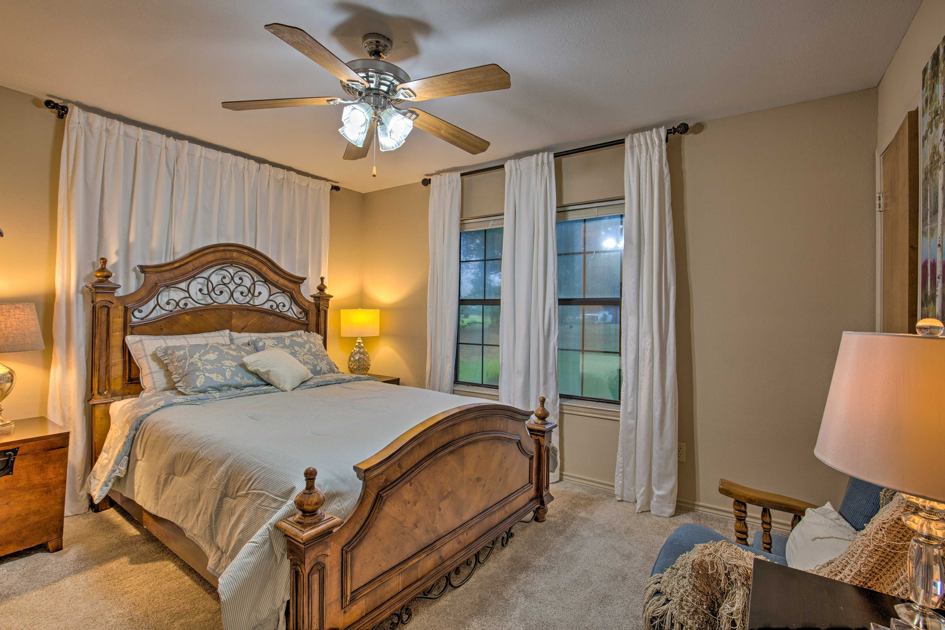 The master bedroom features a queen bed and an en-suite bathroom.