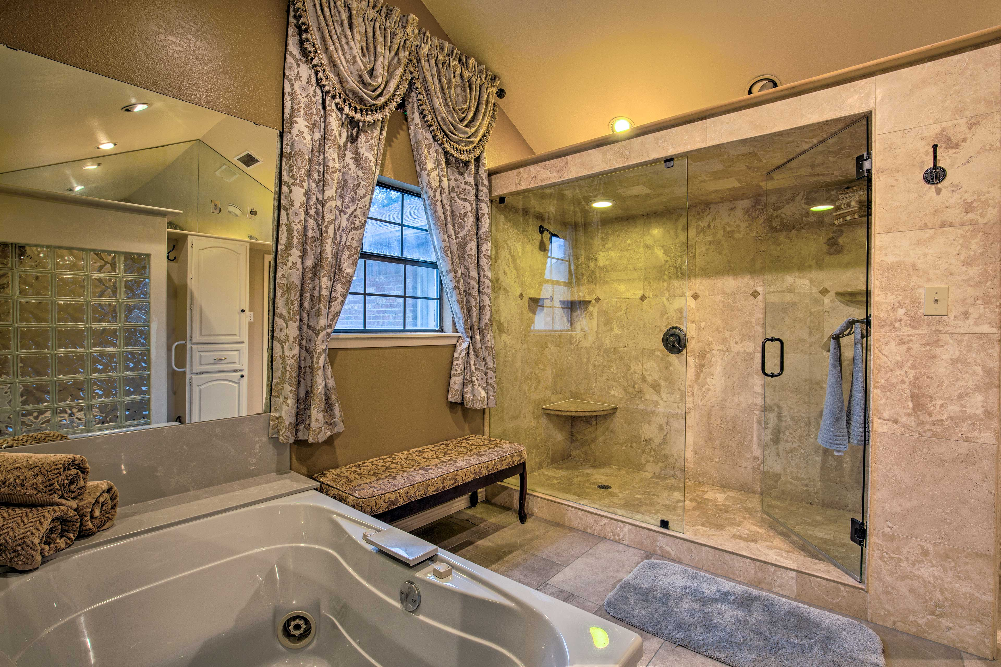 Choose from a soak in the jetted tub or rinse off in the travertine shower.