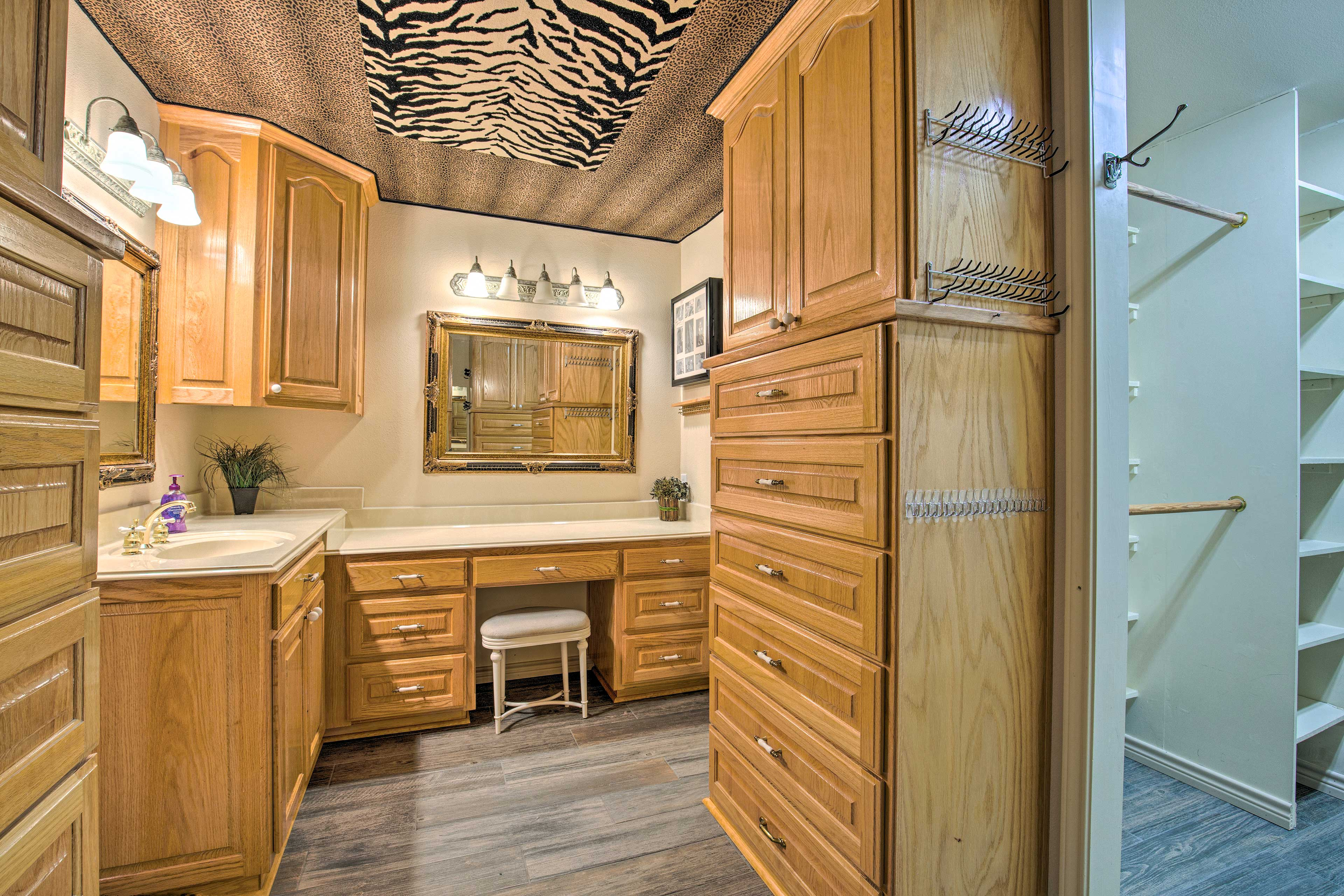 The second spacious bathroom boasts ample space with a vanity.