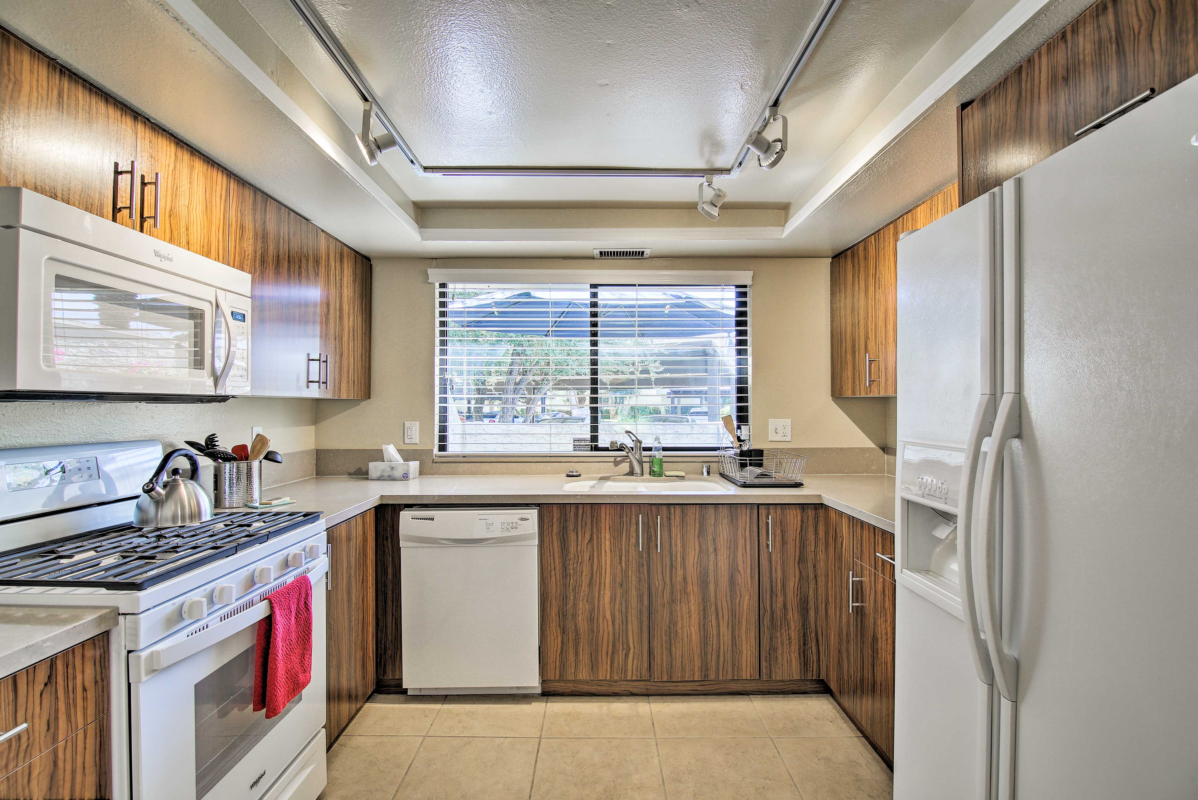 The kitchen features all of the necessary appliances.