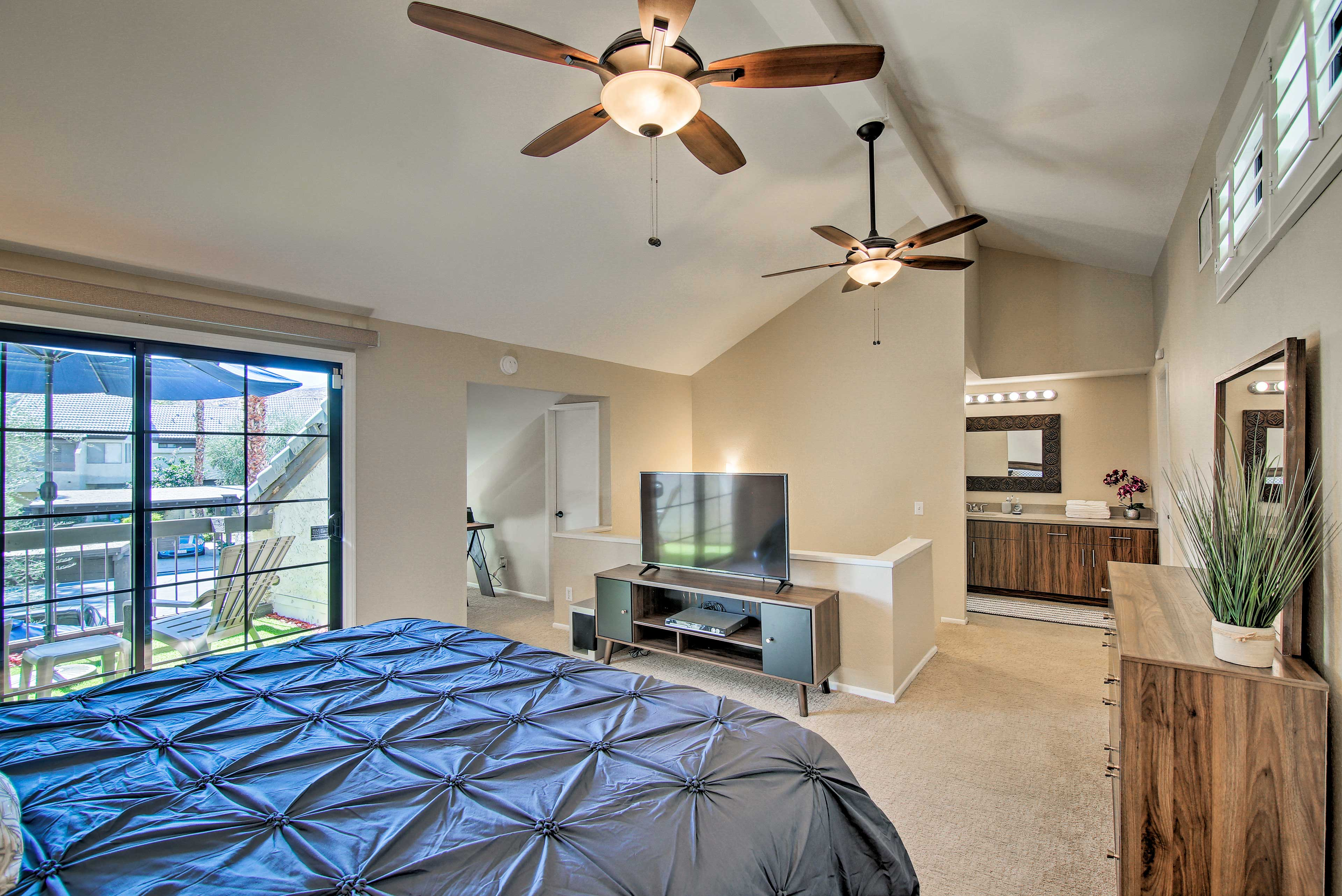 It features a king-sized bed, en-suite bath, and laptop-friendly work space.
