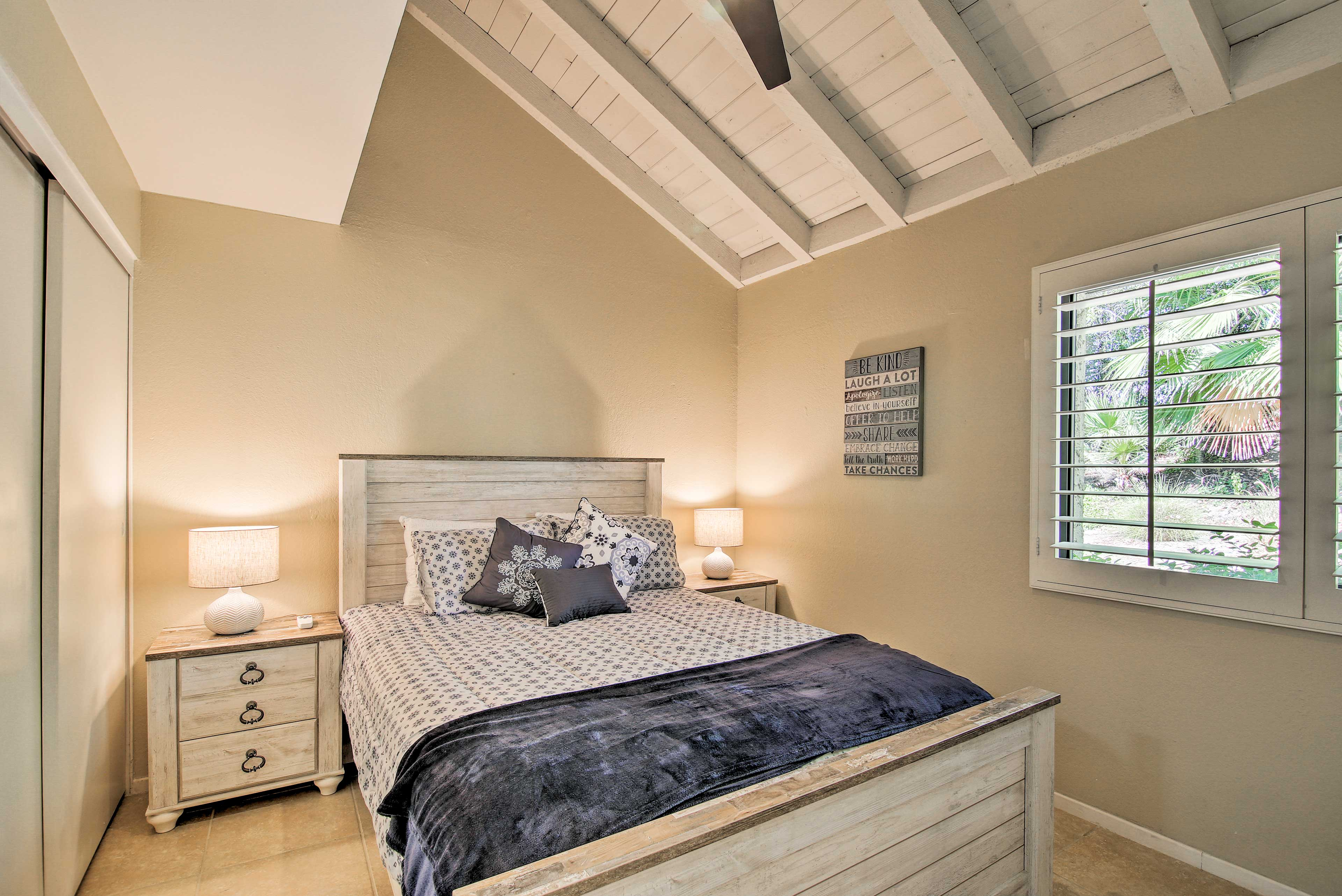 Slip into a deep slumber in this queen-sized bed.