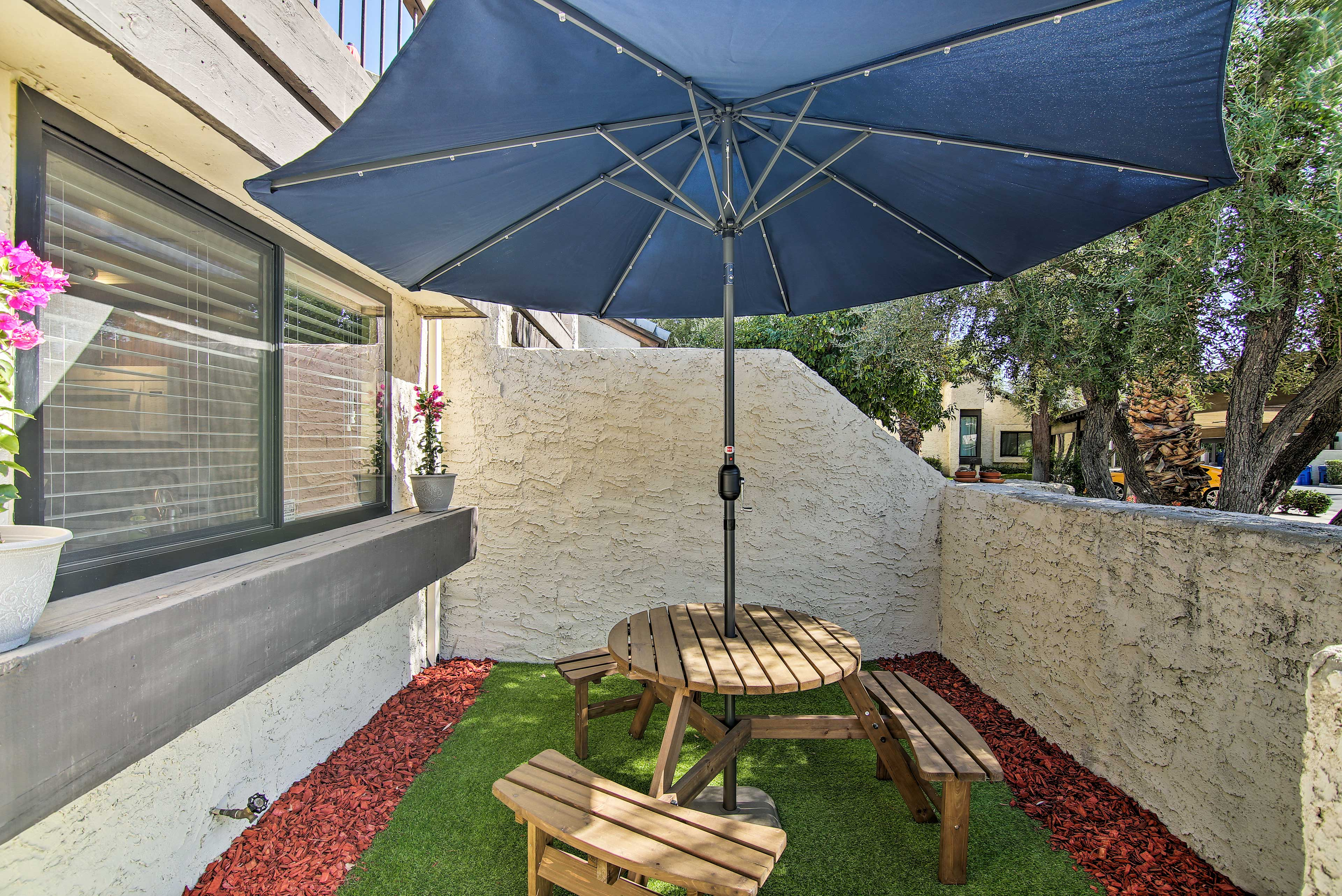 The front courtyard offers a space to enjoy an afternoon picnic.