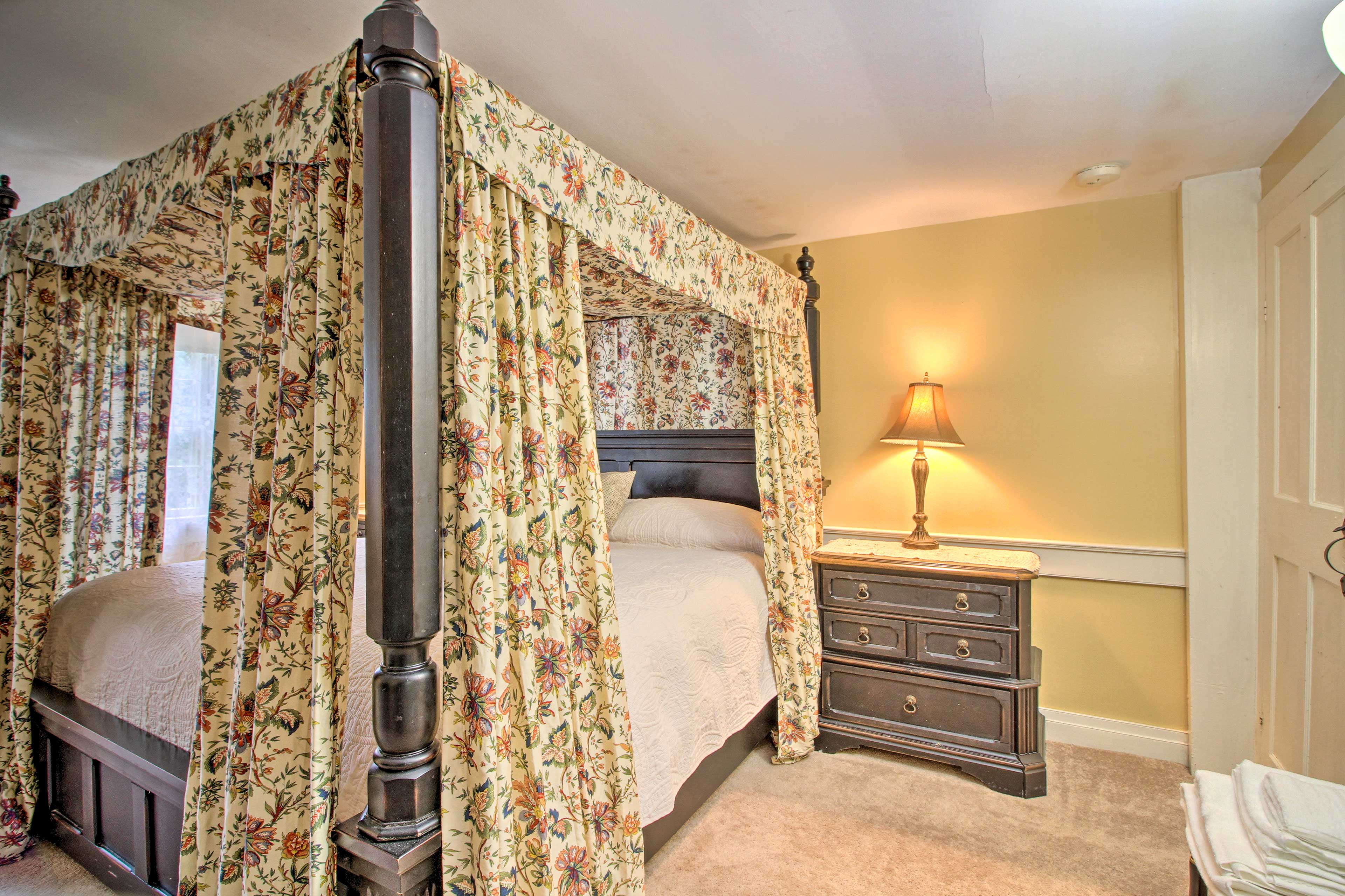 Bedroom 1 features a plush king bed.