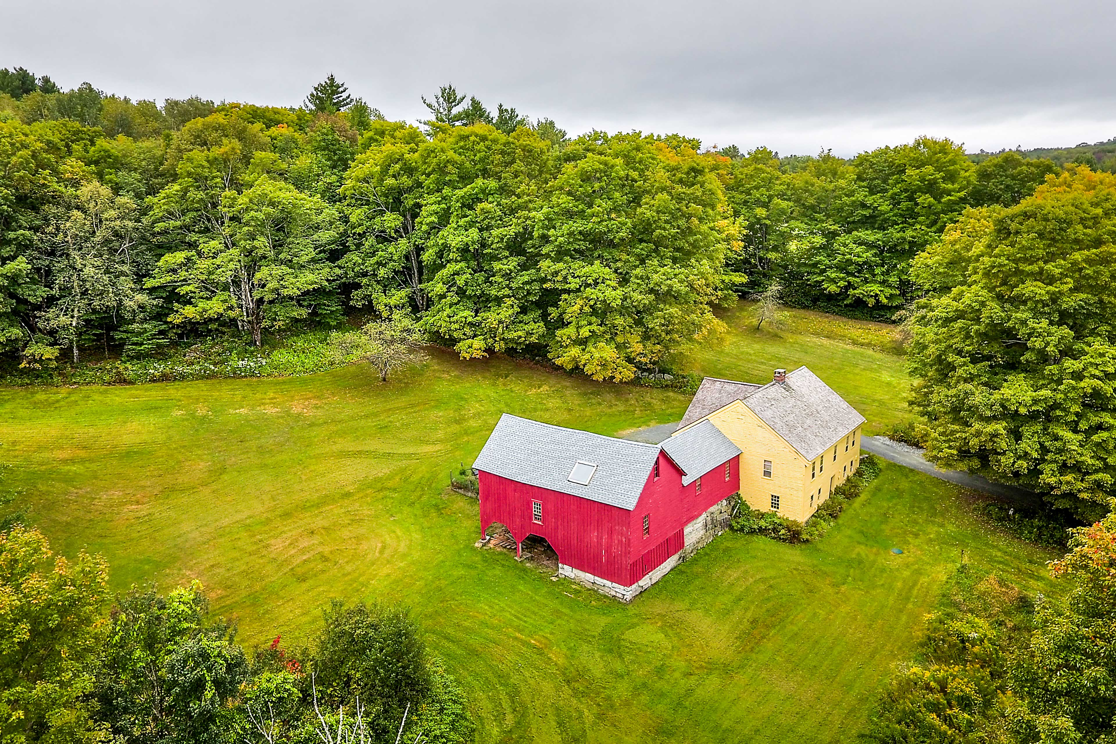This farmhouse sits on 20 private acres nestled beside a preserve.