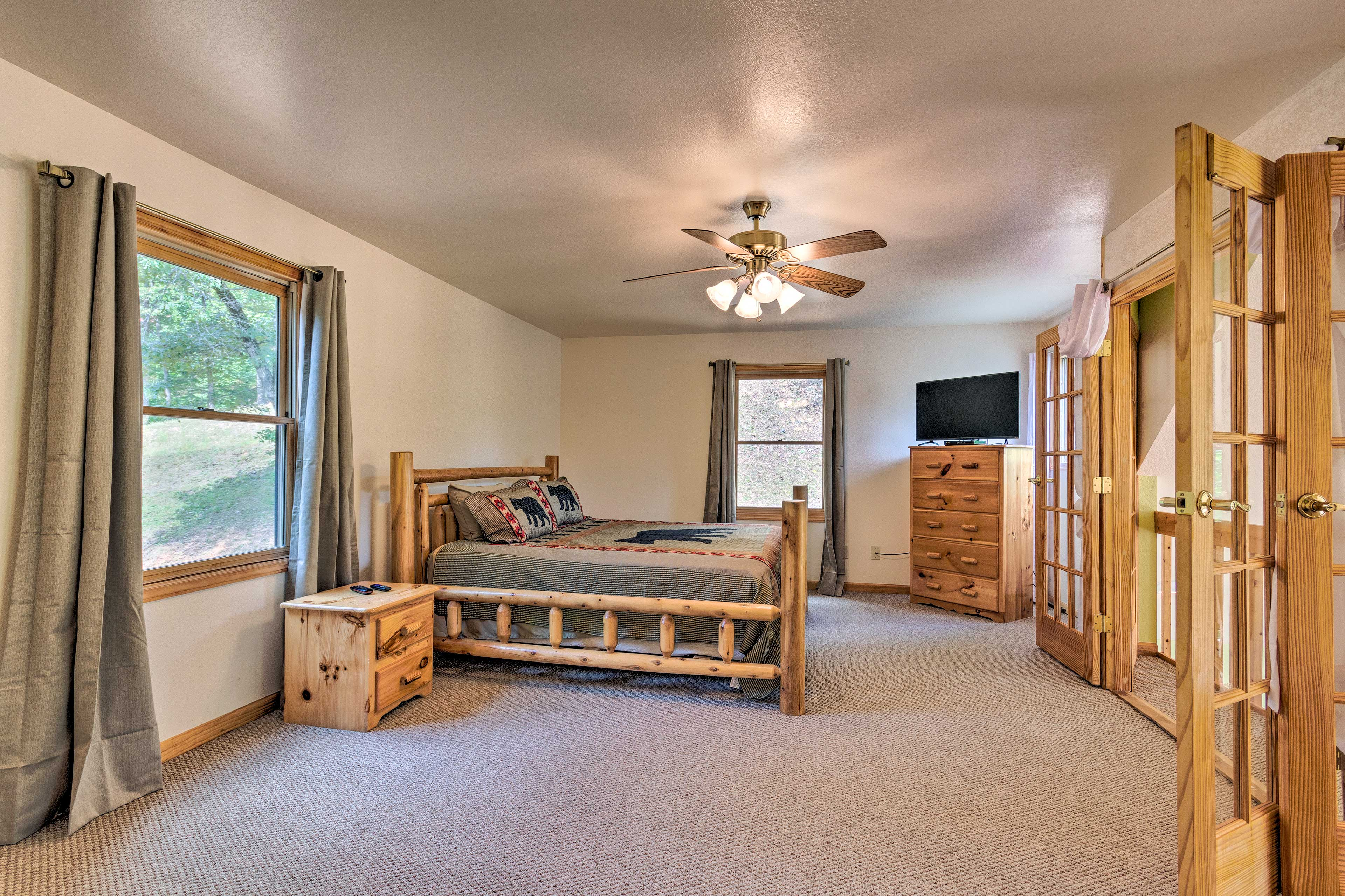 Retreat to the master bedroom for the night in the log-framed king-sized bed.