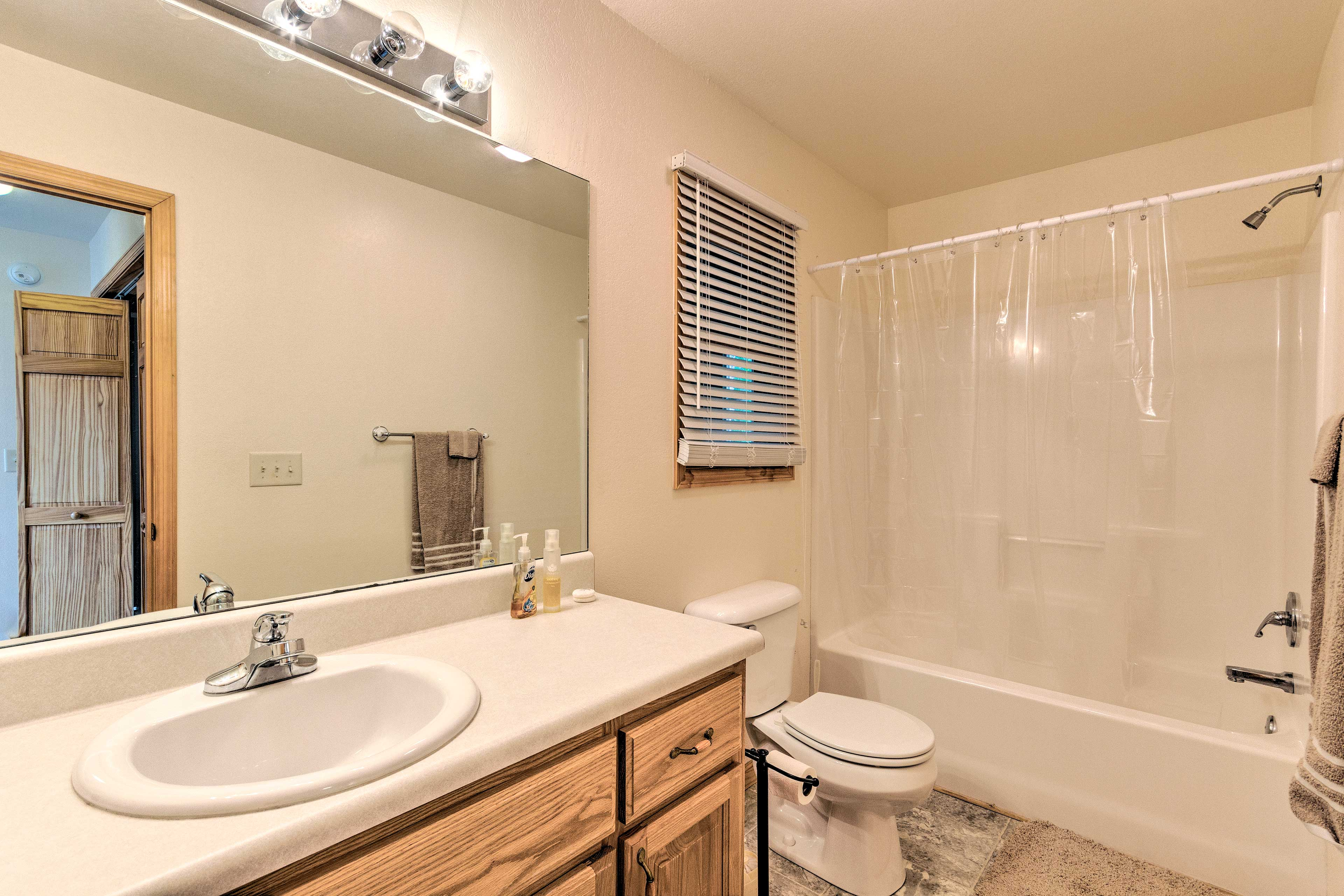 The home comes with 2 full baths, both with plenty of lighting and cabinetry!