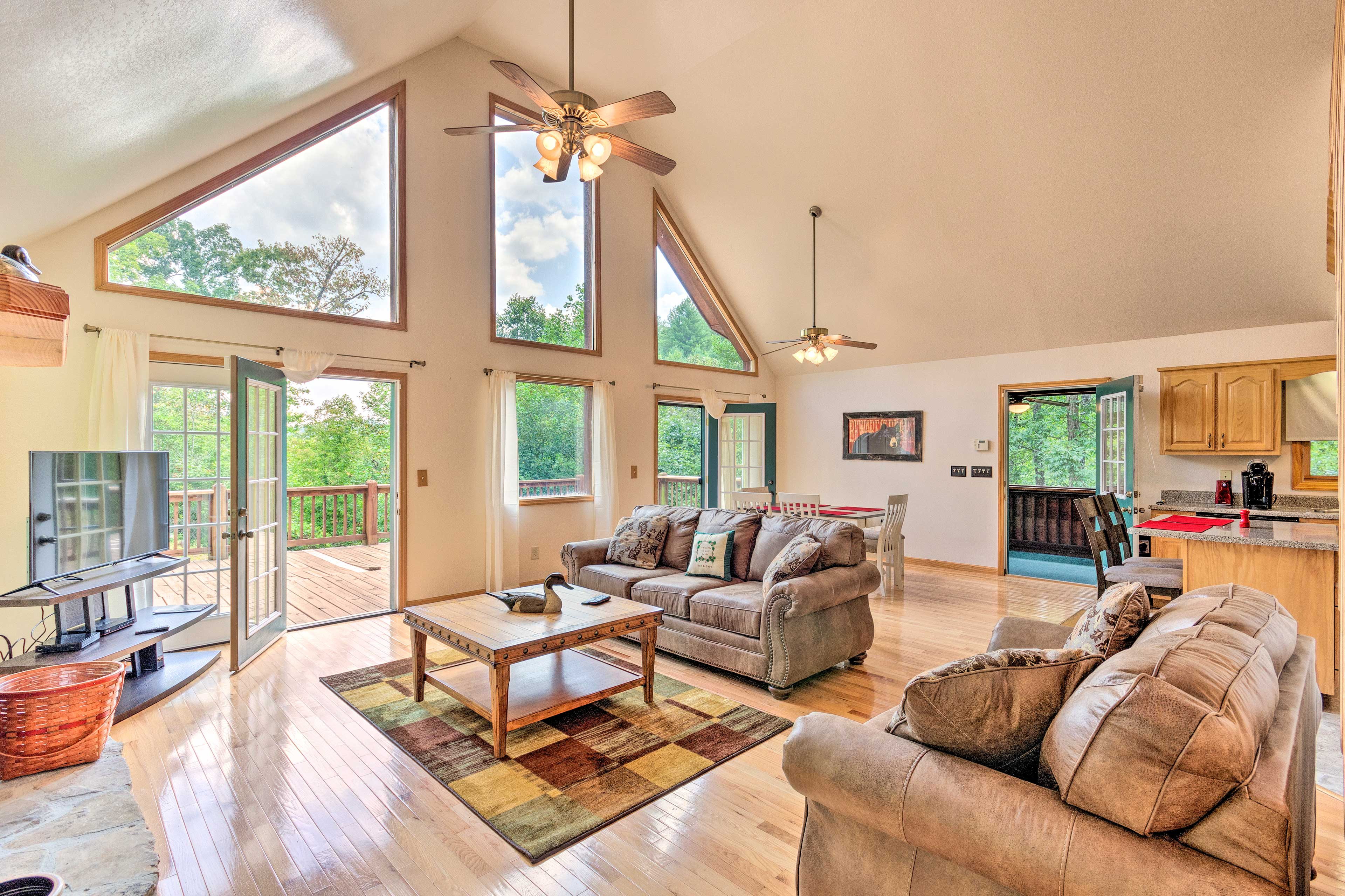 The interior and exterior of this spacious home offer stunning forest views!