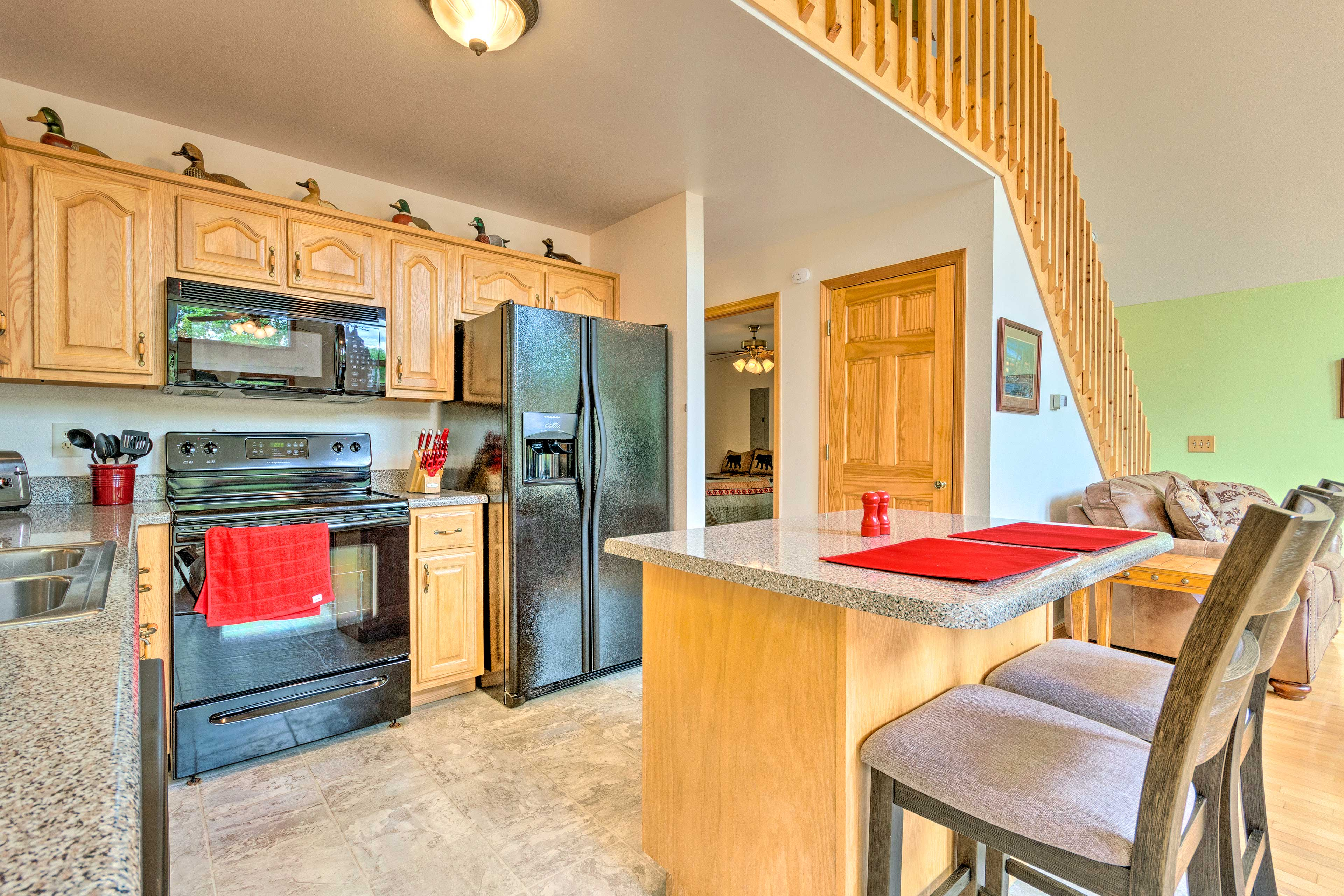 The kitchen features a knife set, a Keurig coffee maker, and plenty of storage!