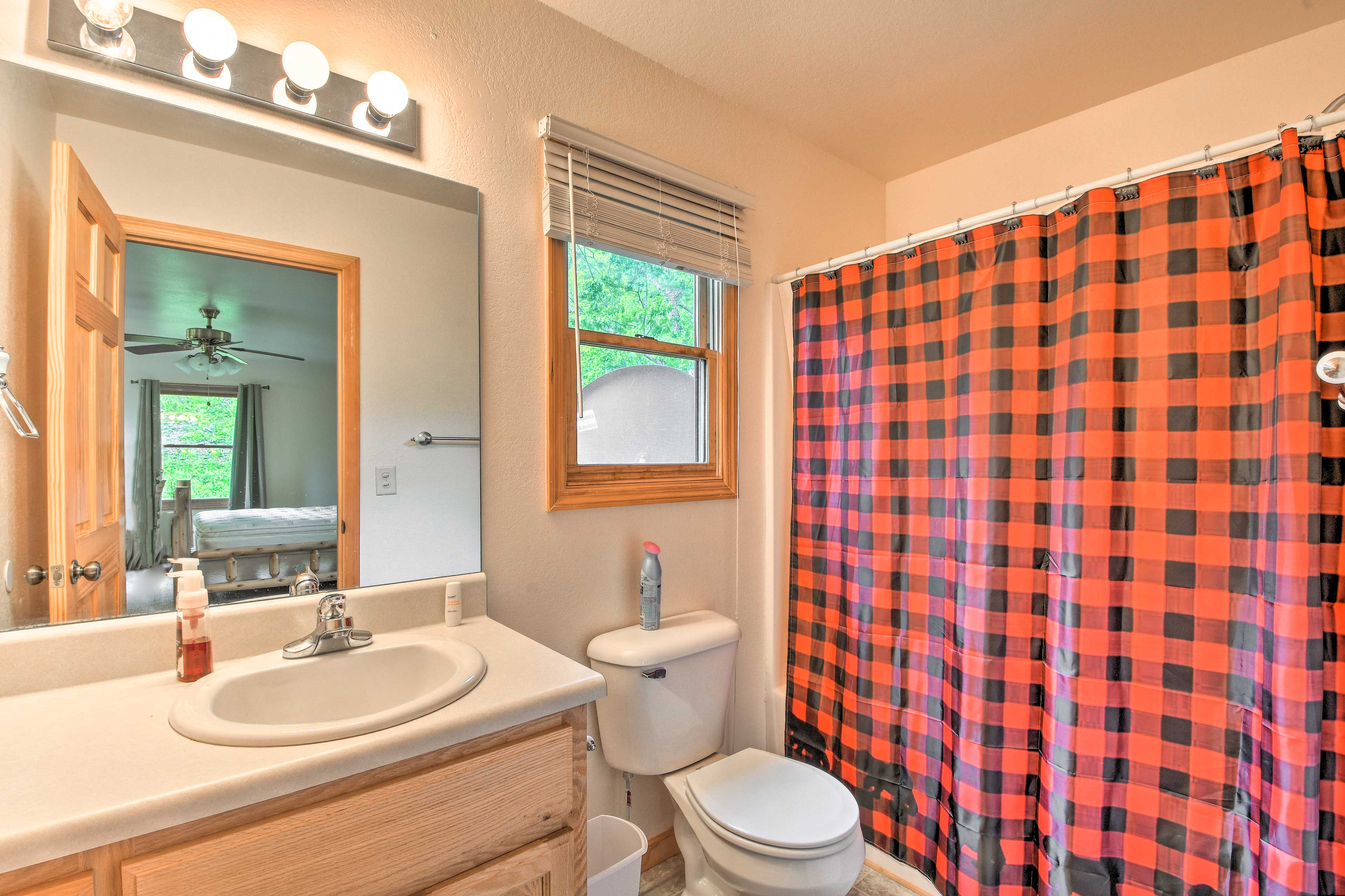 Freshen up in the master bath before a day of outdoor recreation begins!