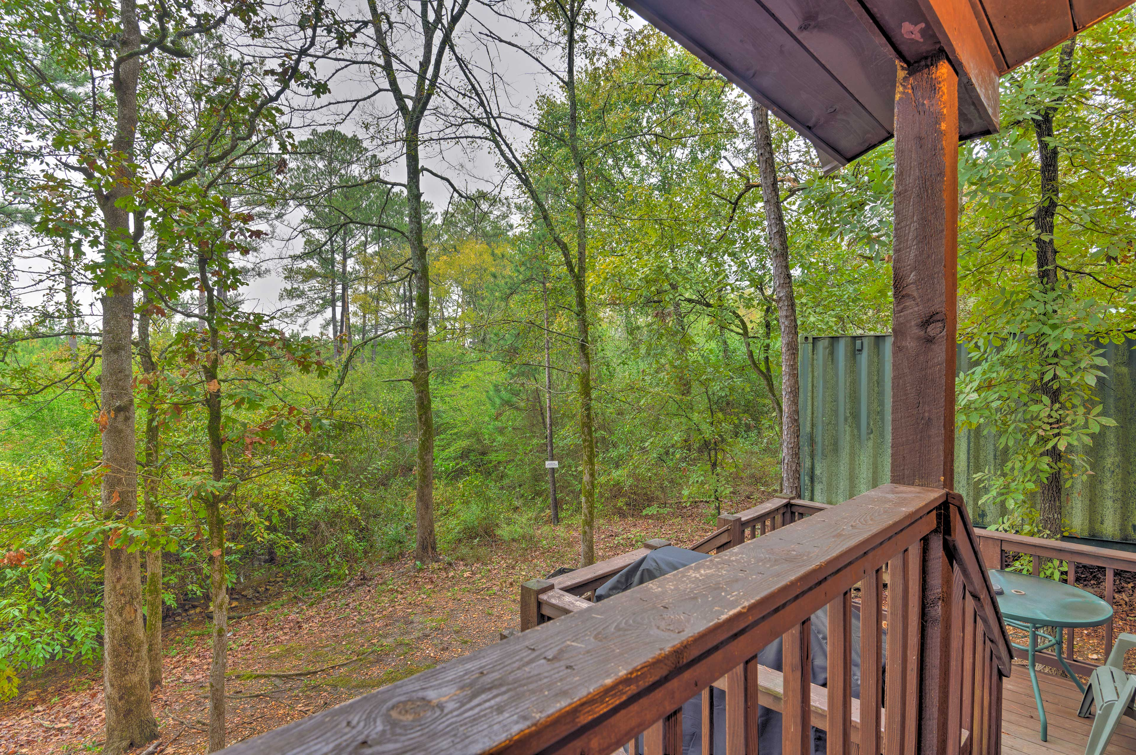 The deck features a gas grill and an outdoor dining table.