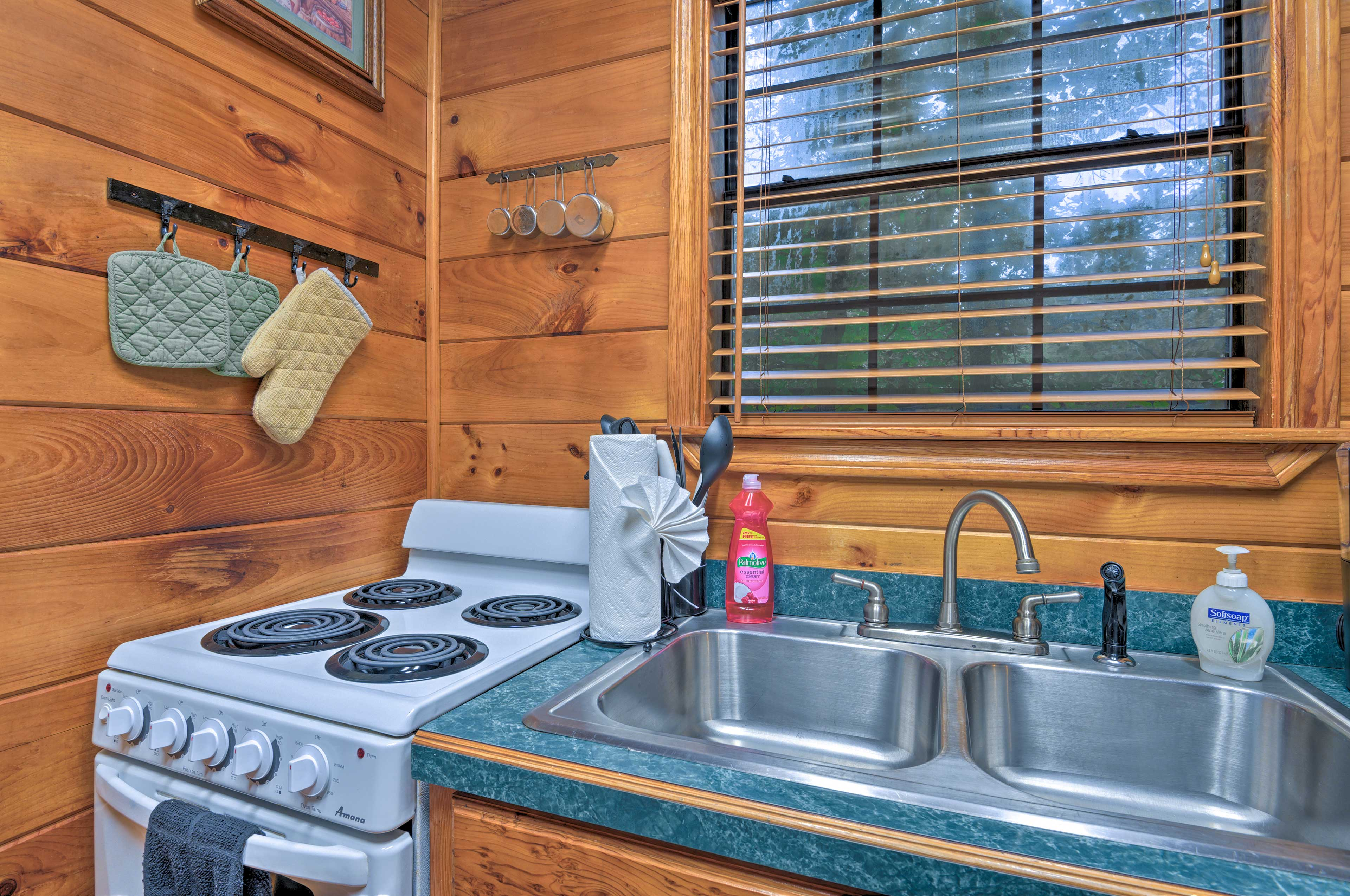 Well equipped, the kitchen features a full fridge and stove/oven.
