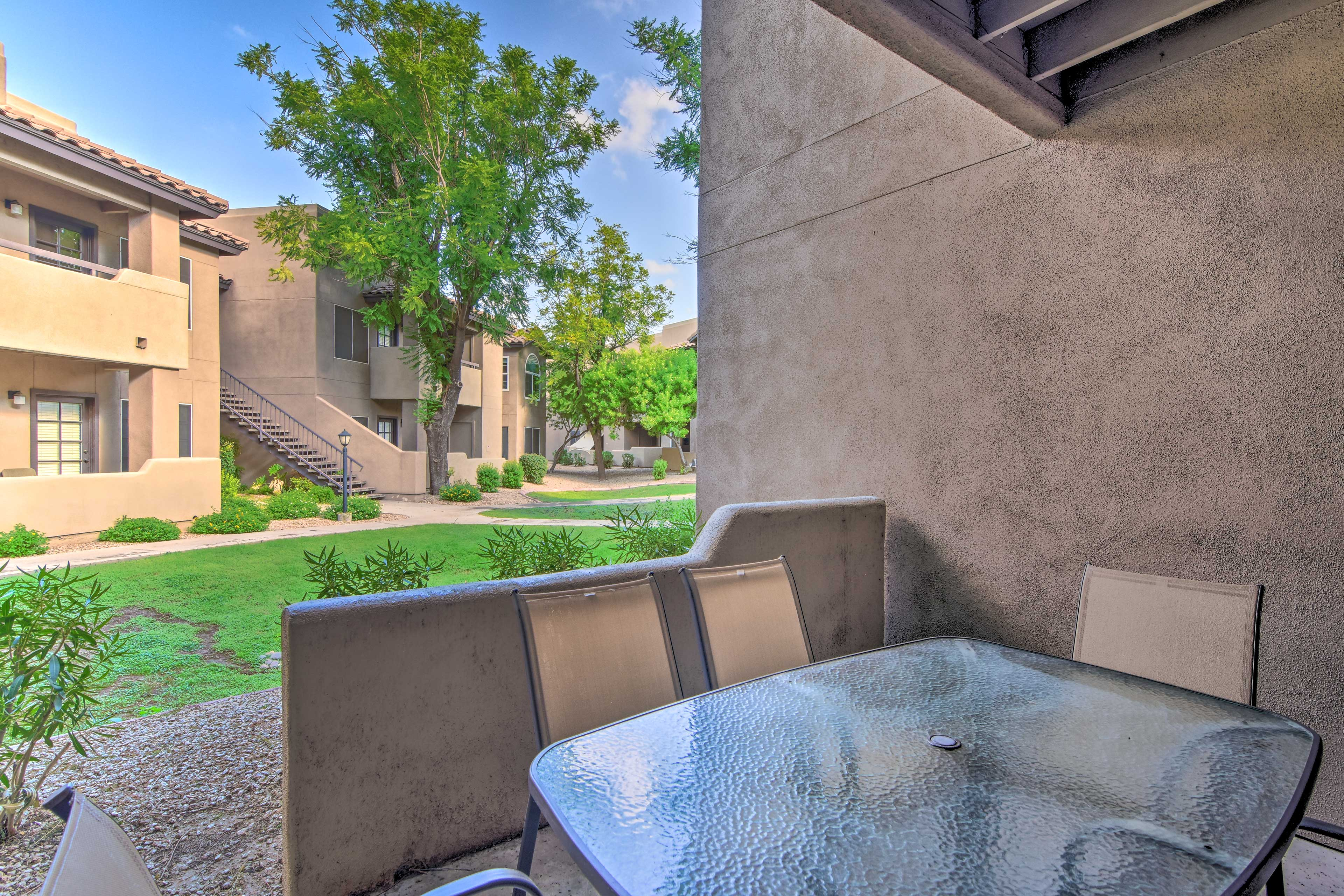 The terrace includes an outdoor table.