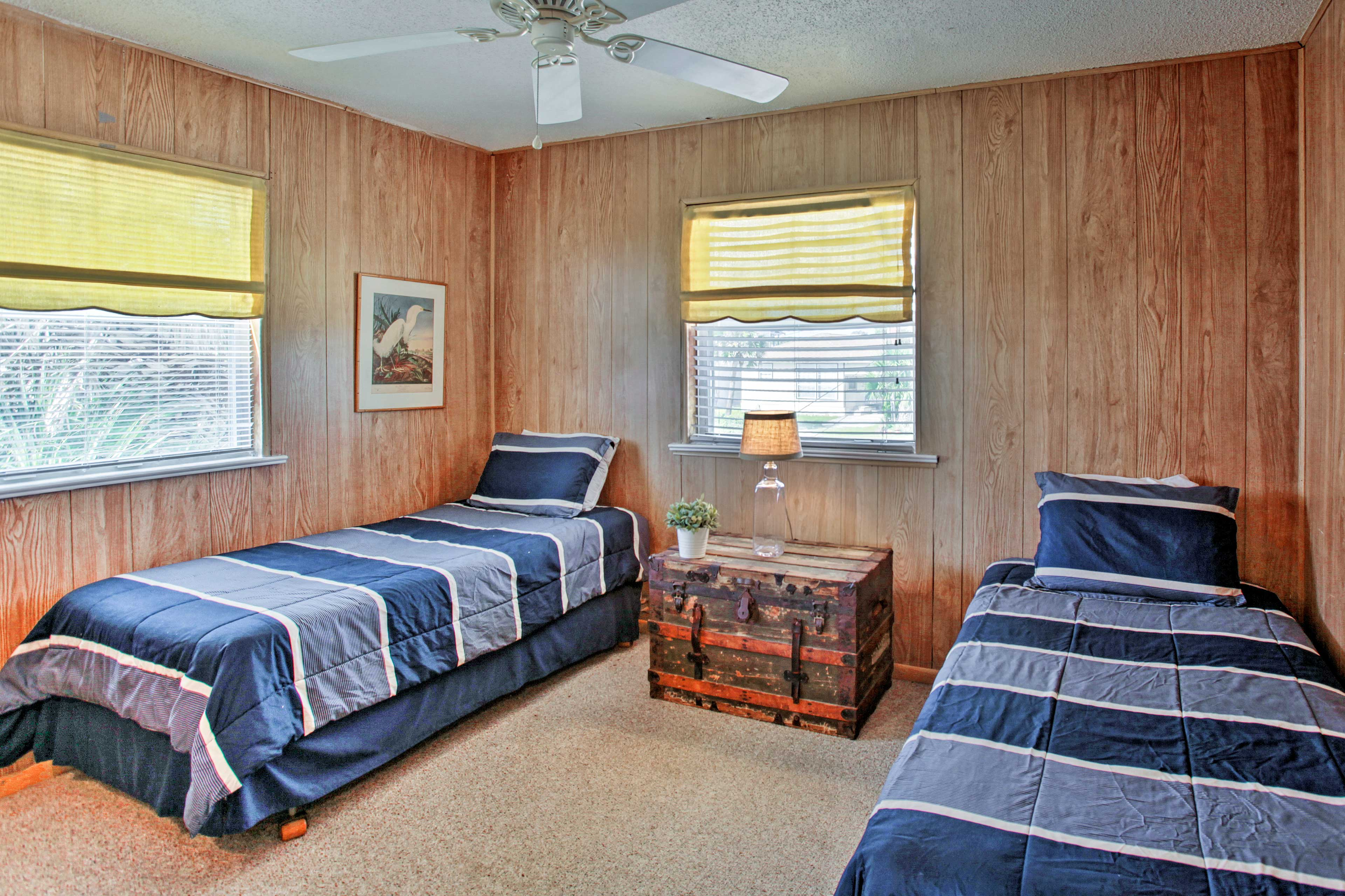 The second bedroom features 2 twin beds.