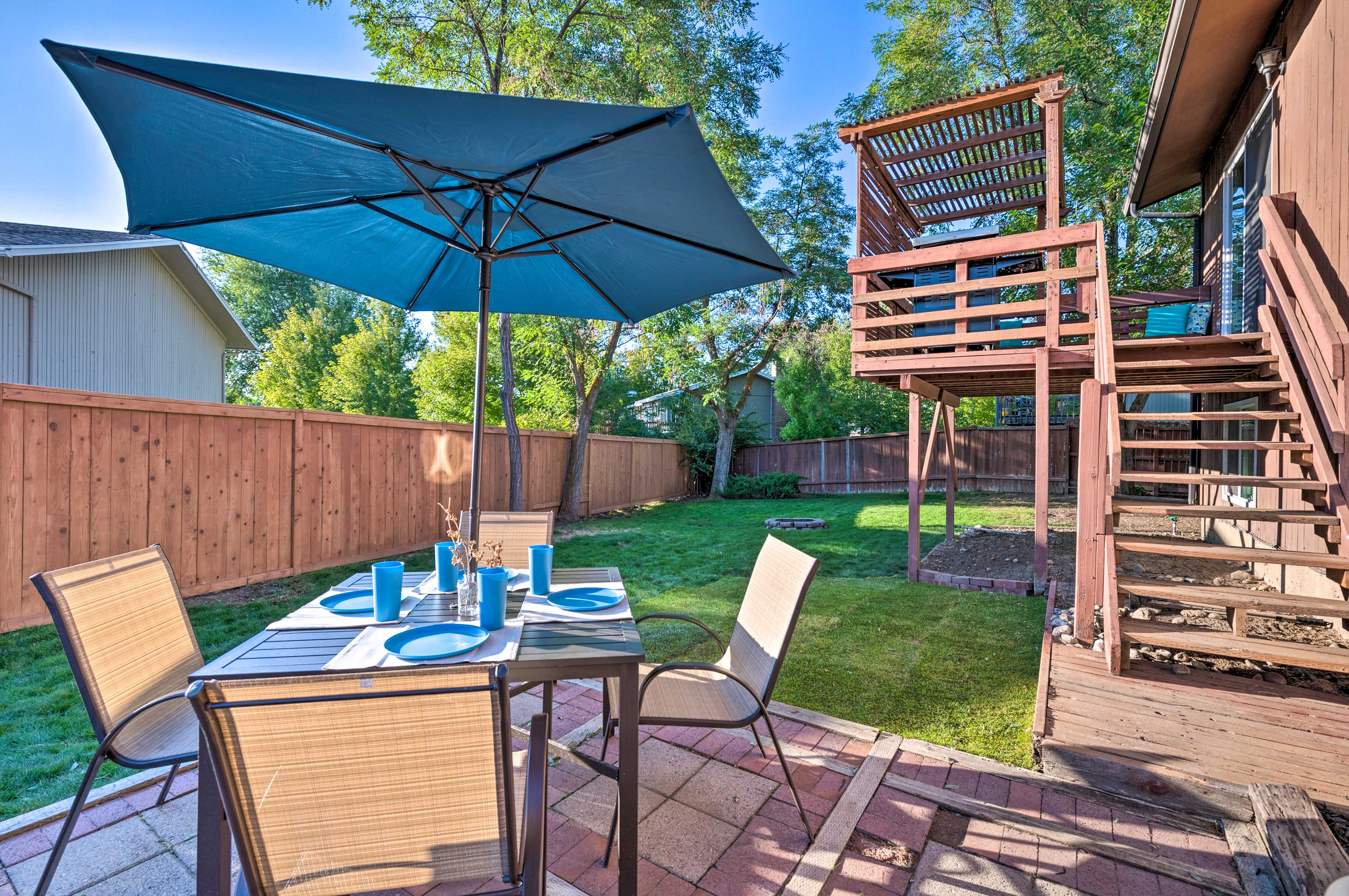 Enjoy a meal together on the back patio of this vacation rental.