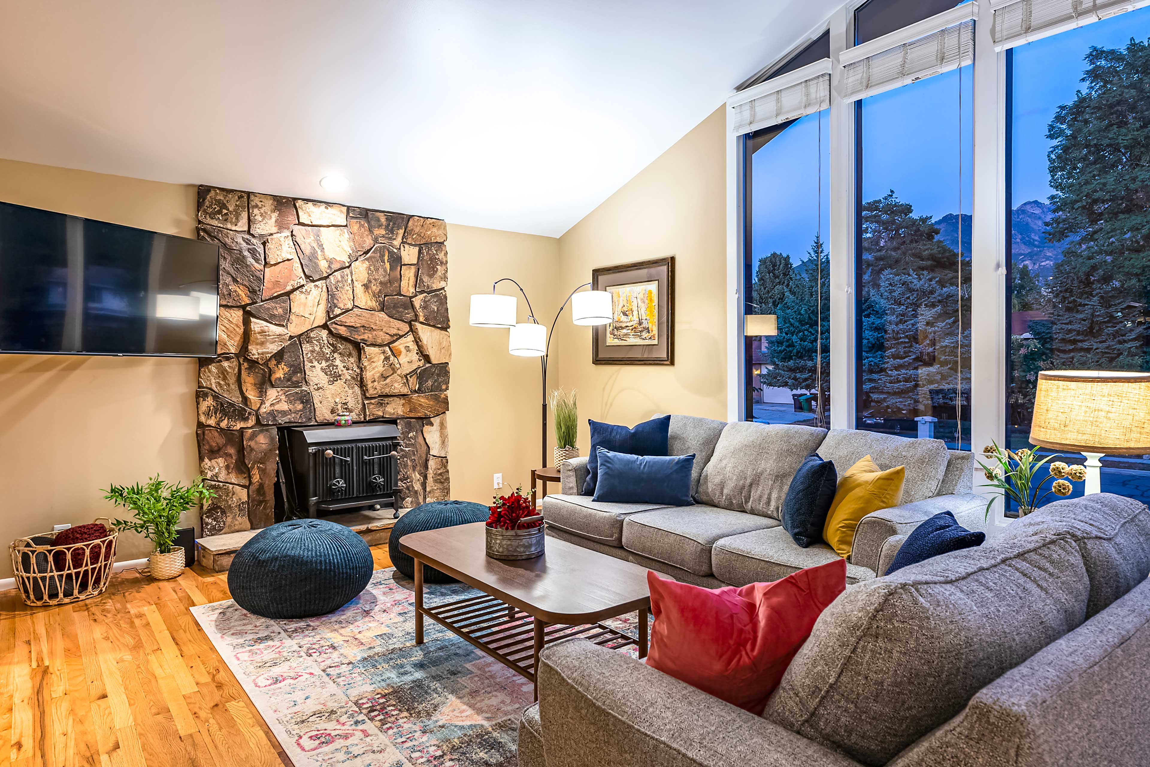 Gather in the living room around the Smart TV and wood-burning stove.