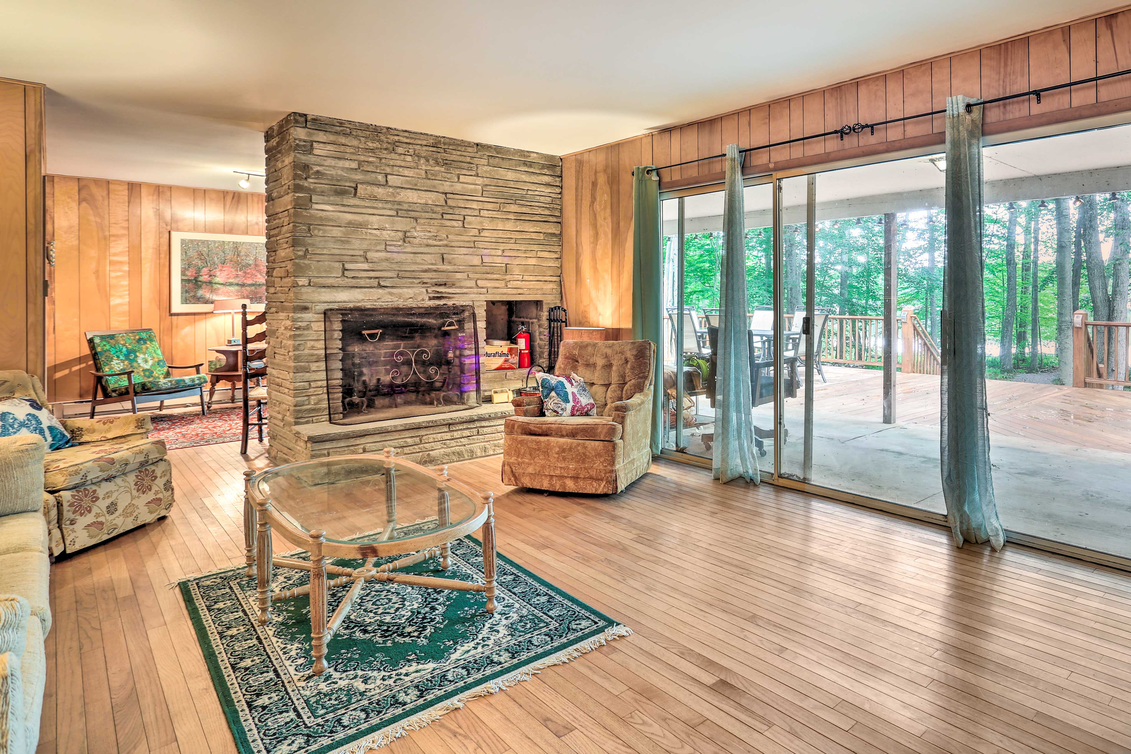 Appreciate hardwood flooring and paneling making this home a Poconos classic!