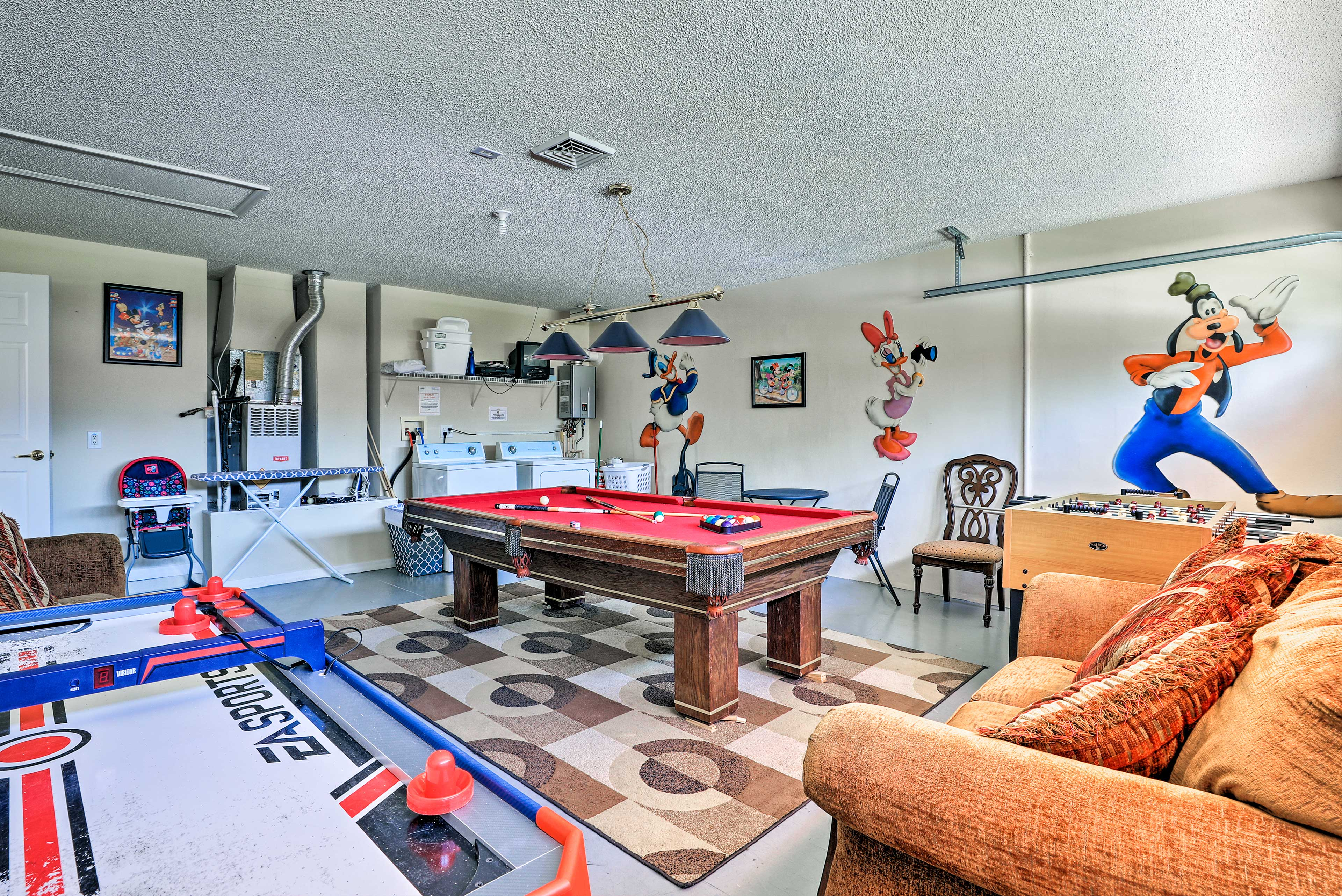 The game room features a foosball, pool, and ping pong table all for you!