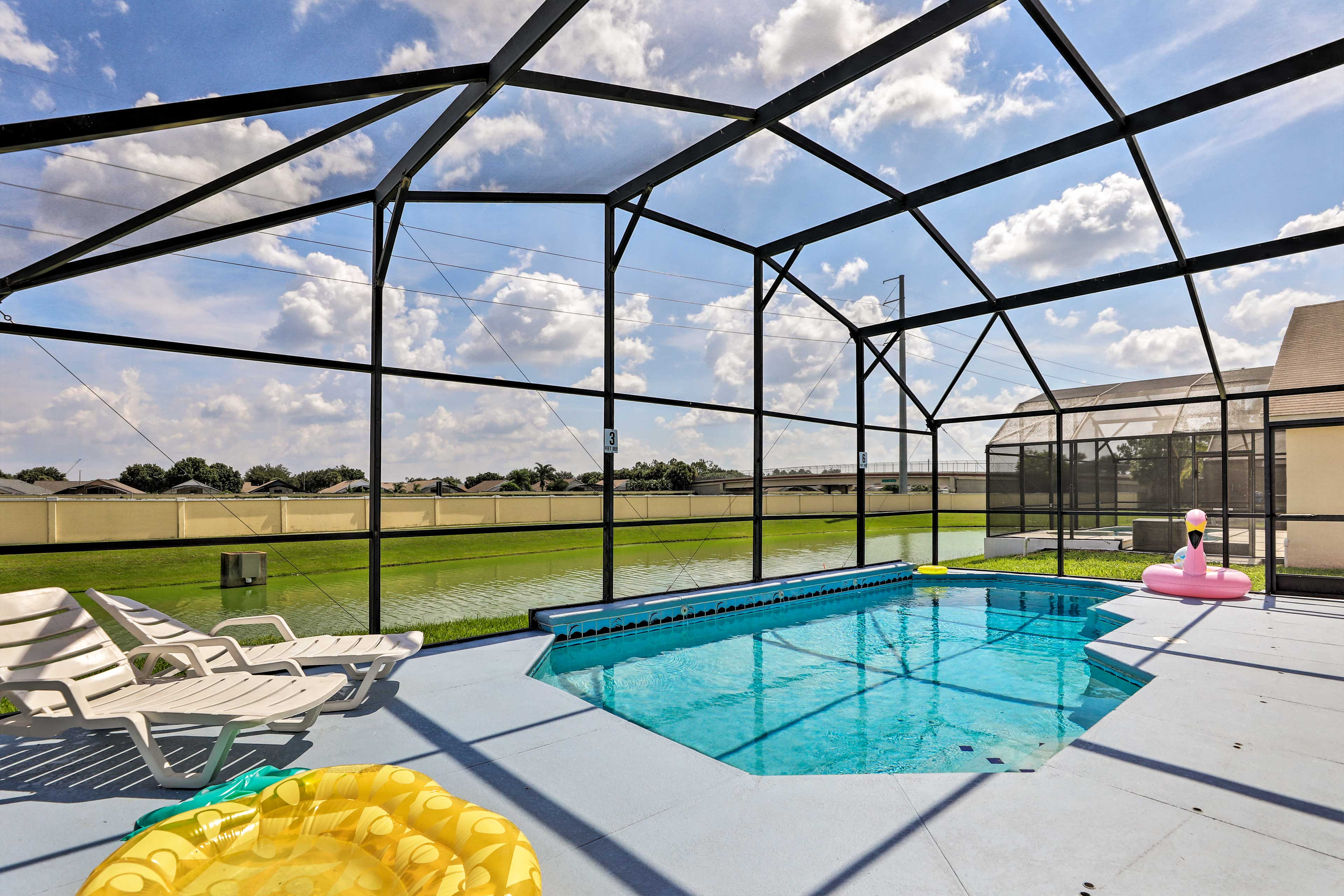Enjoy your stay at this 4-bed, 3-bath vacation rental with a screened-in pool.