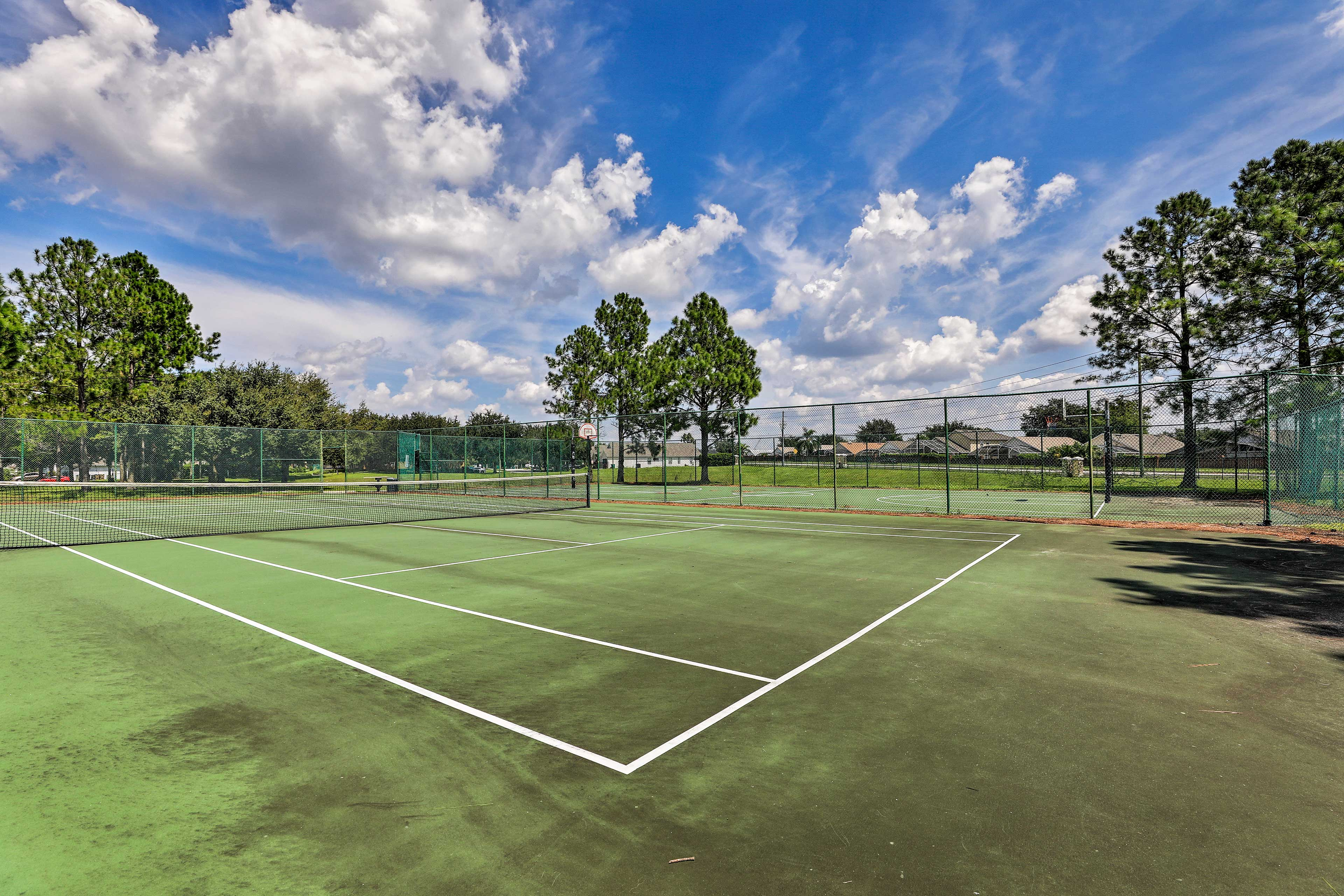 Challenge your family to a tennis match.