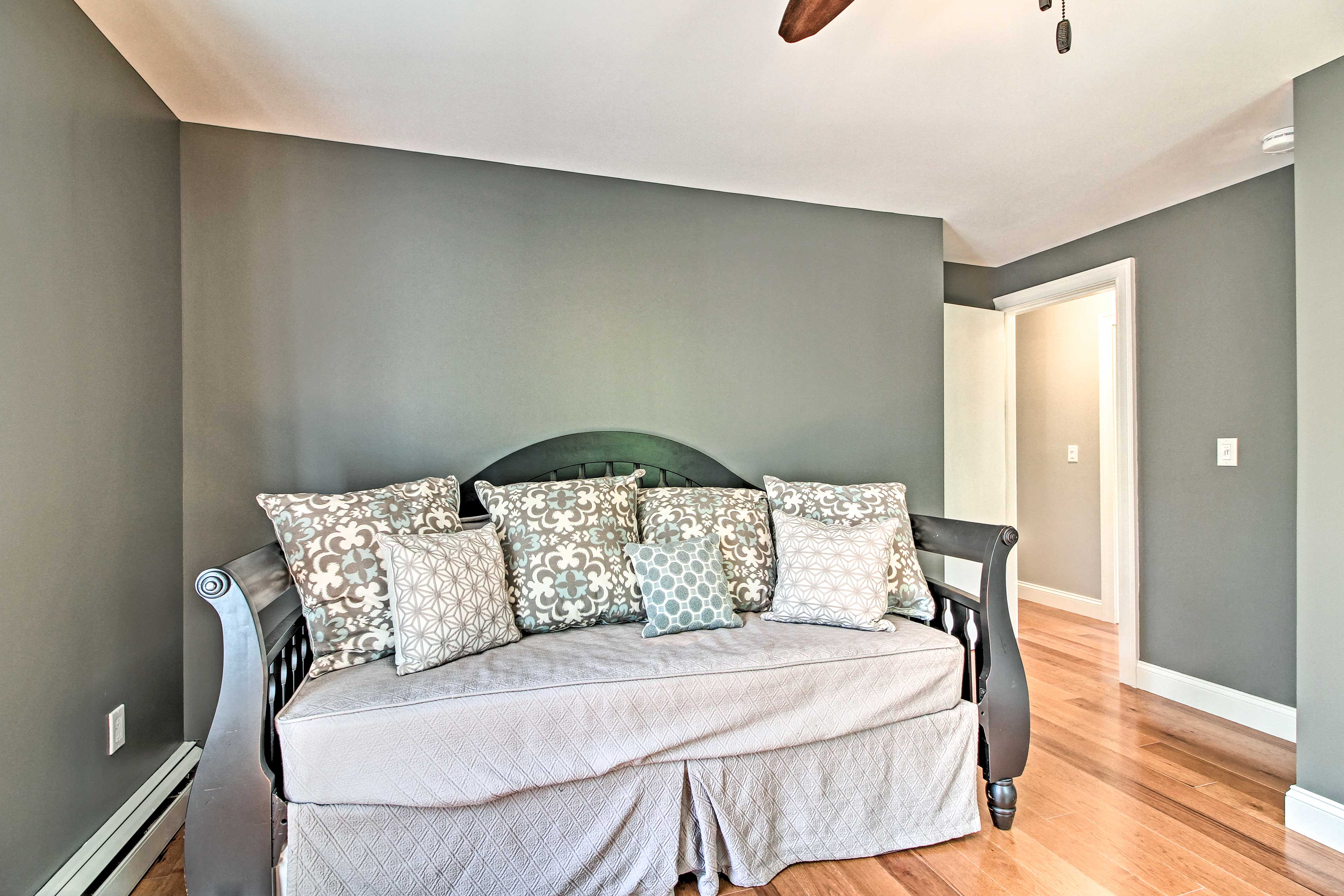 This bedroom includes a twin daybed and twin trundle bed.