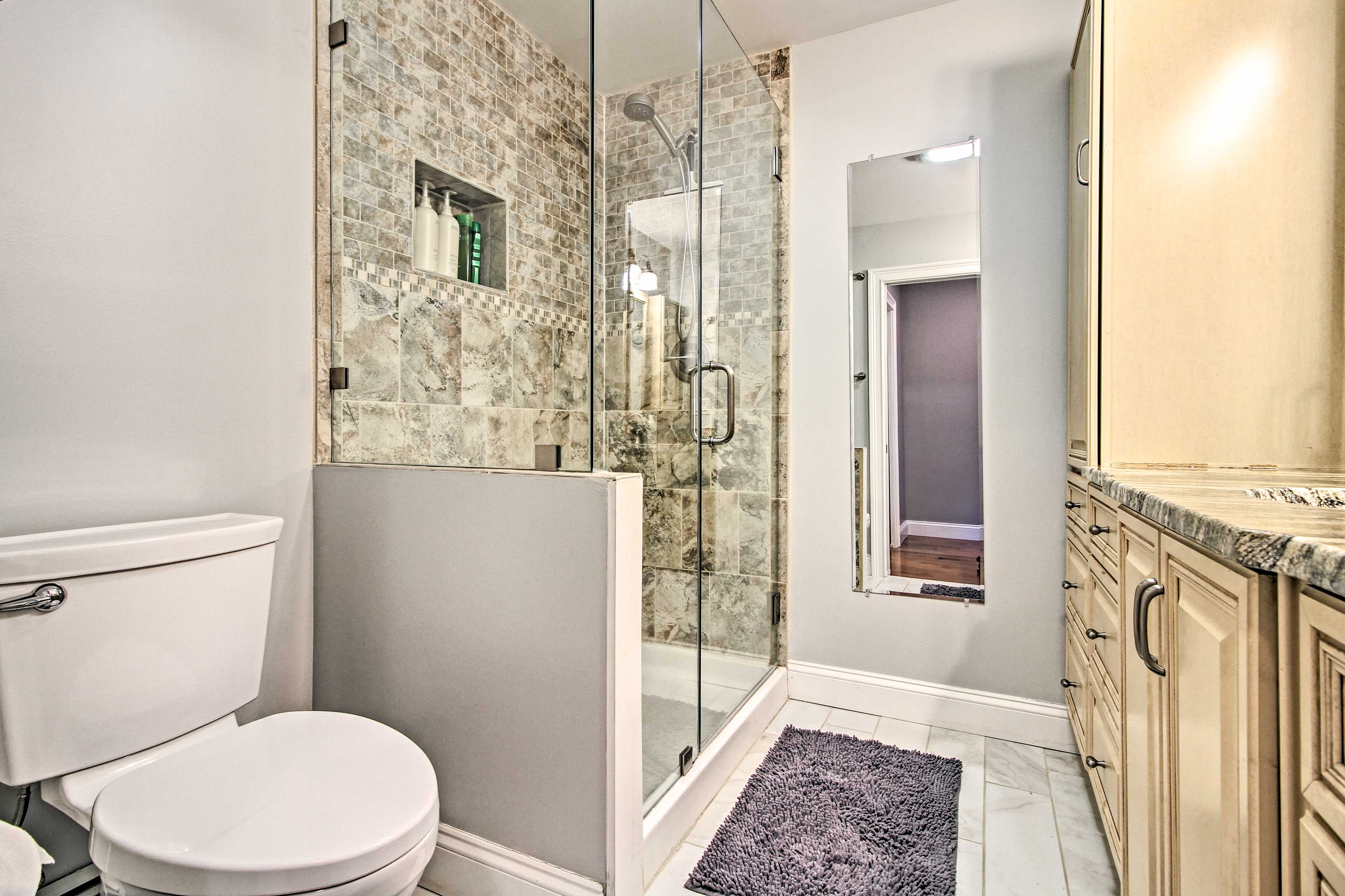 This pristine bathroom offers the perfect start to each day.
