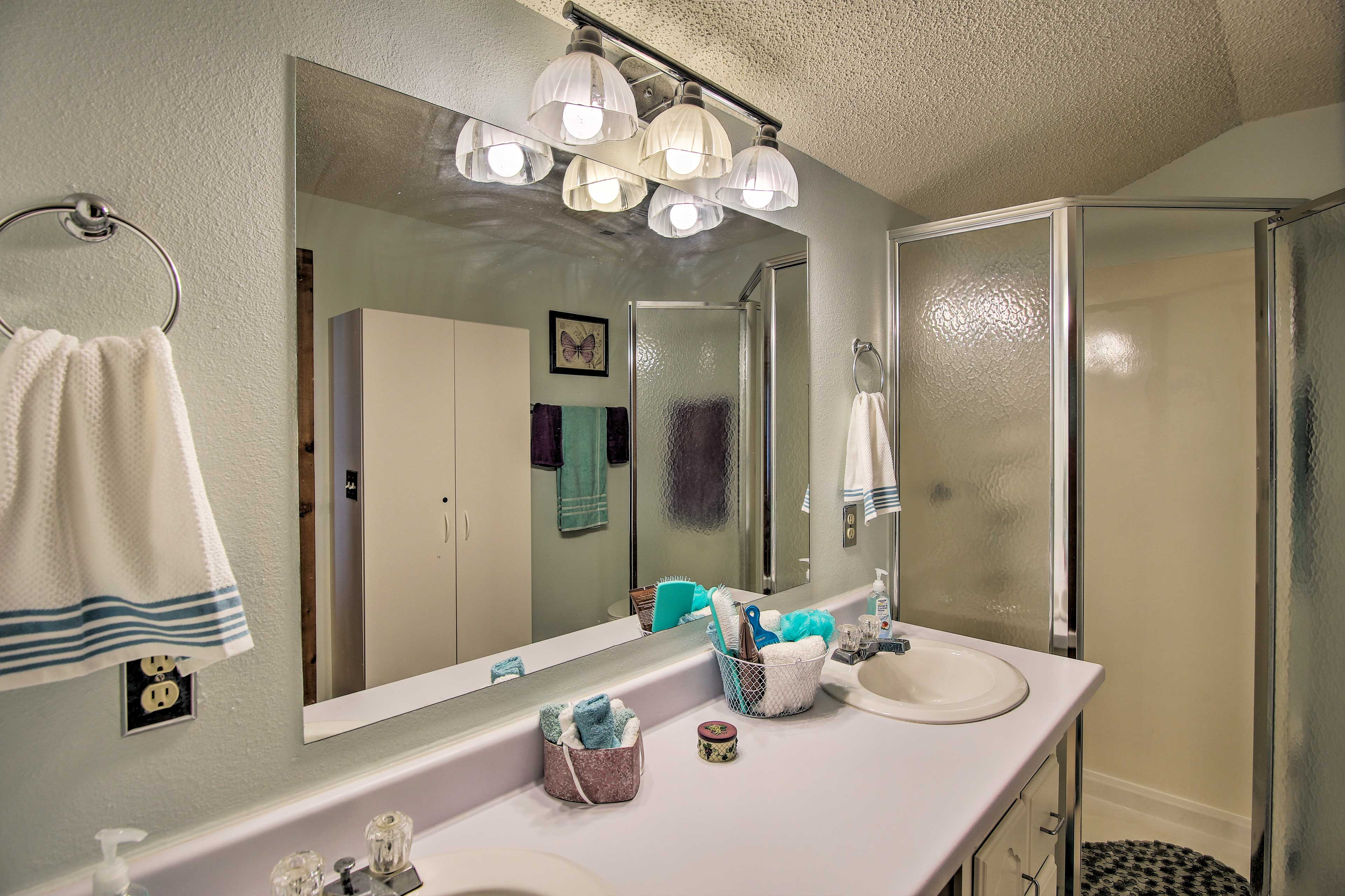 Freshen up at the dual sink bathroom counter.