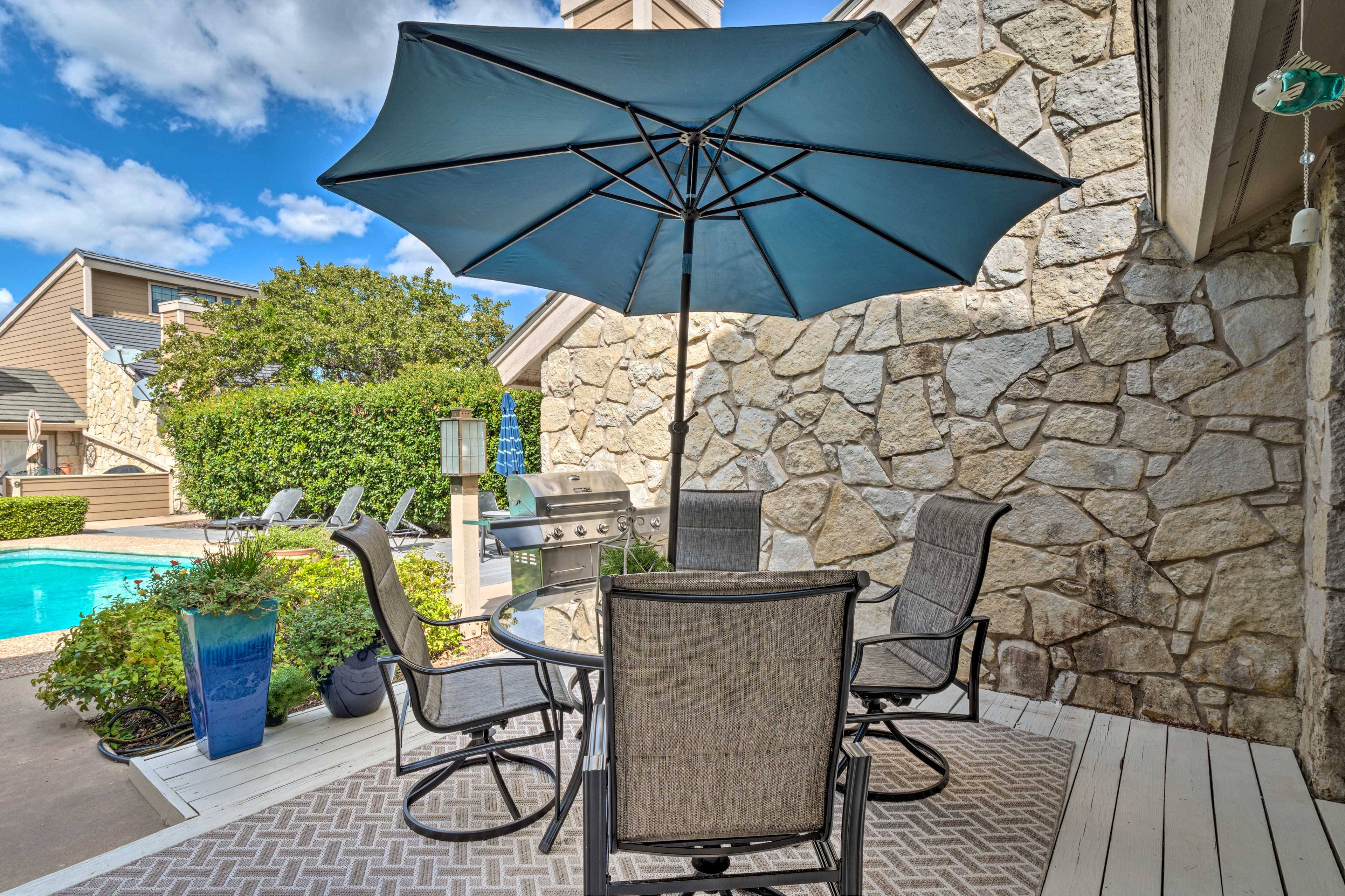 Enjoy a beverage out on the patio overlooking the community pool.