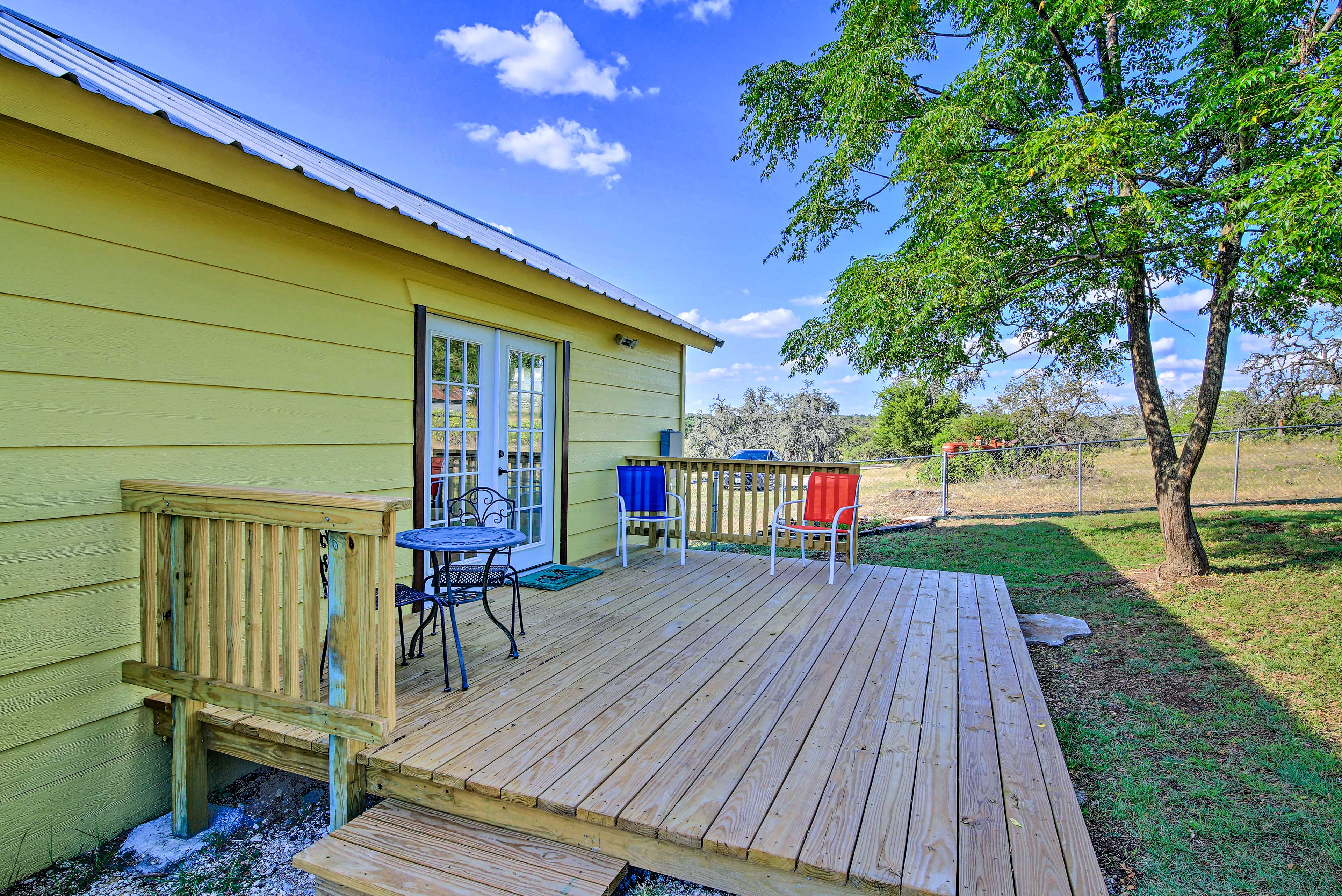 The cabin also has a back deck with a fenced-in yard.