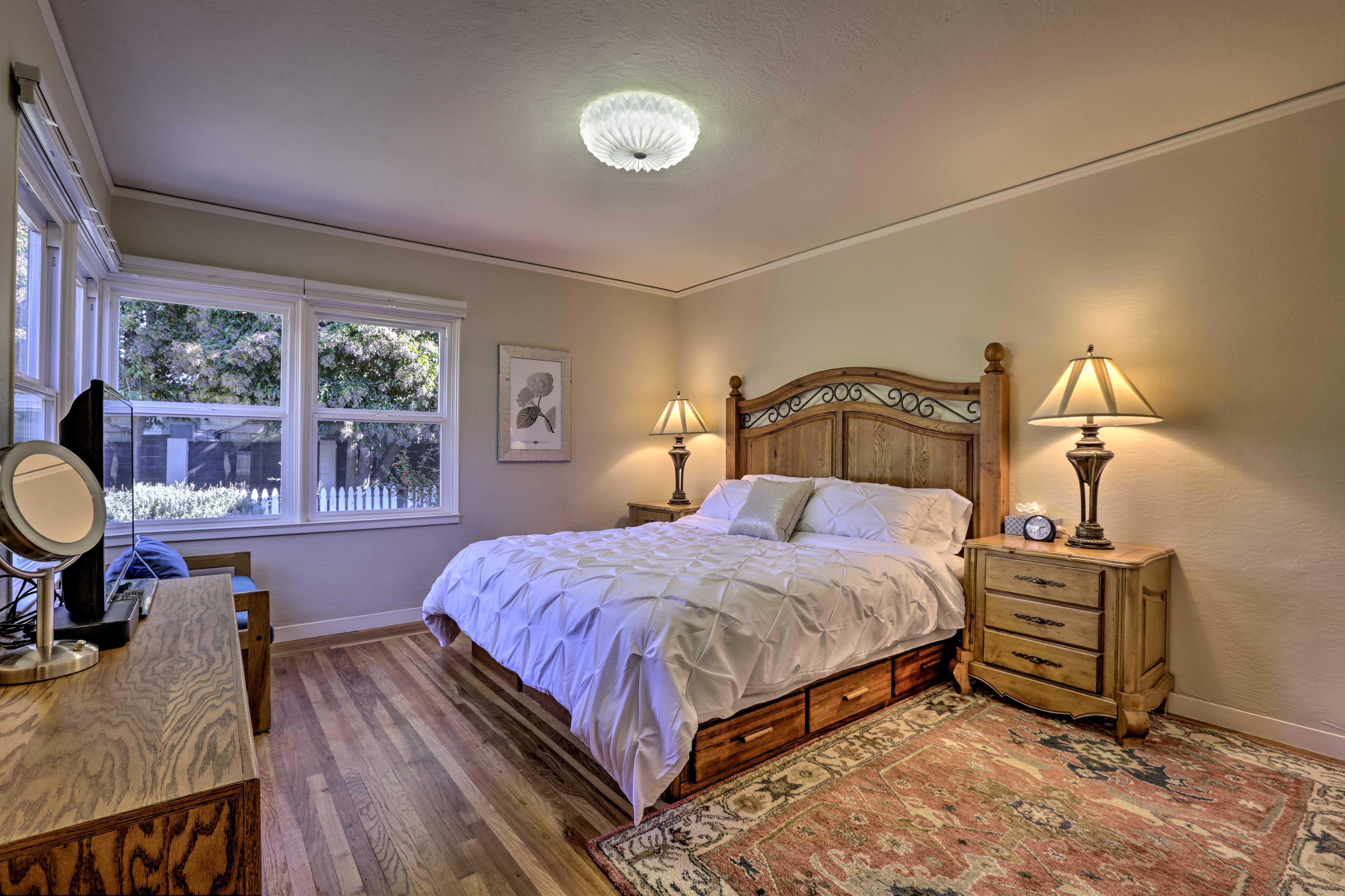 The master bedroom boasts a California king bed.