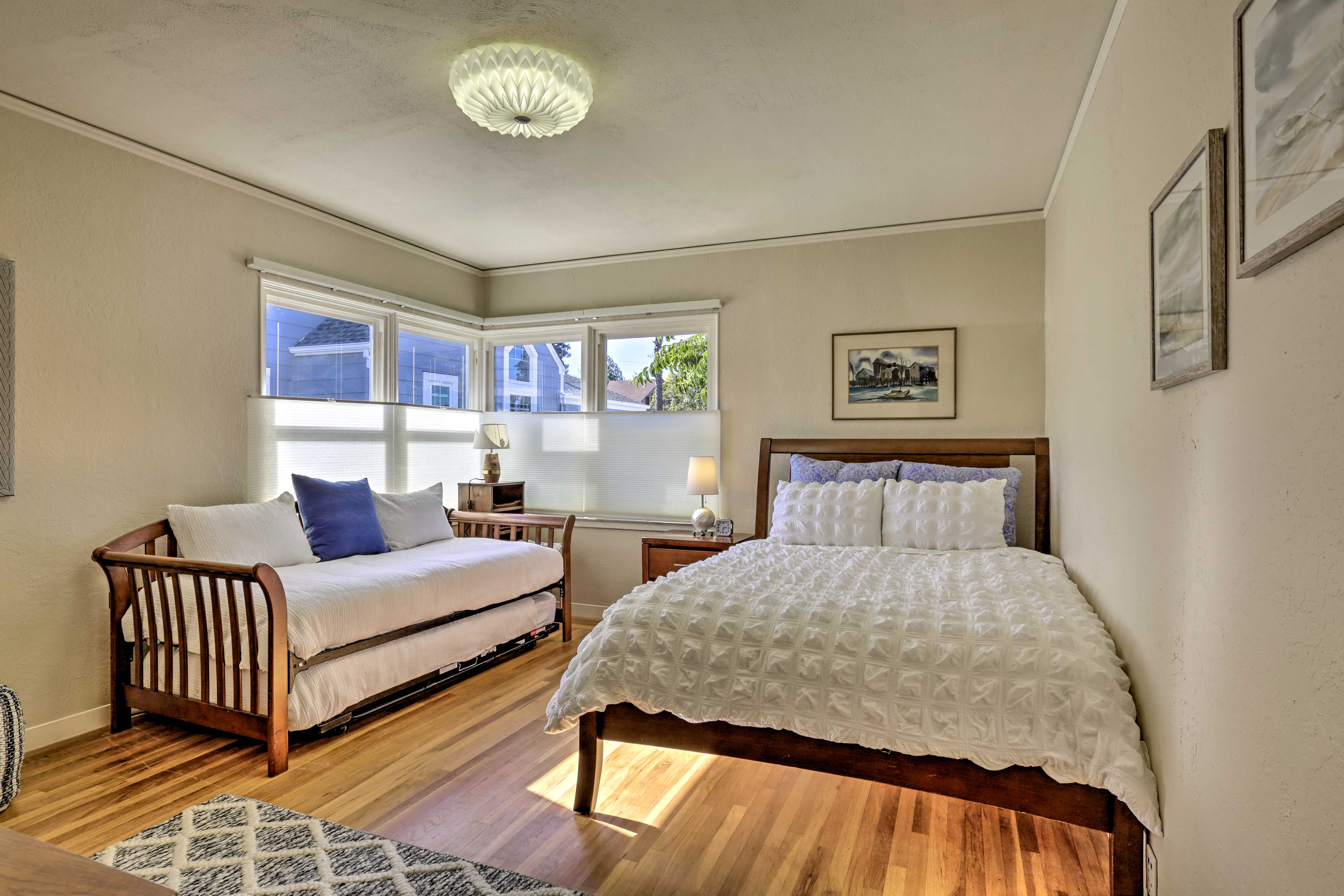 The second bedroom includes a queen bed and 2 twin beds.