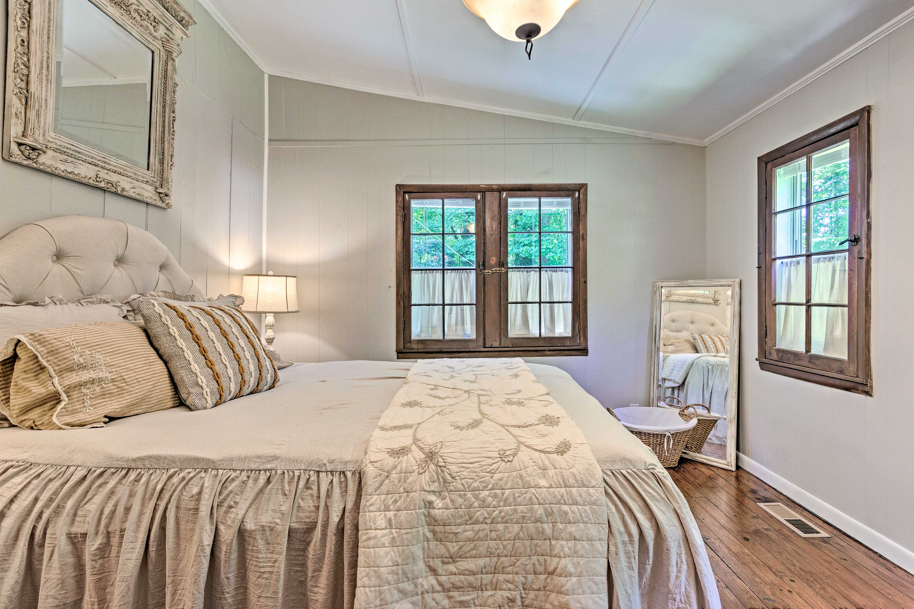 This corner bedroom has ample natural light.