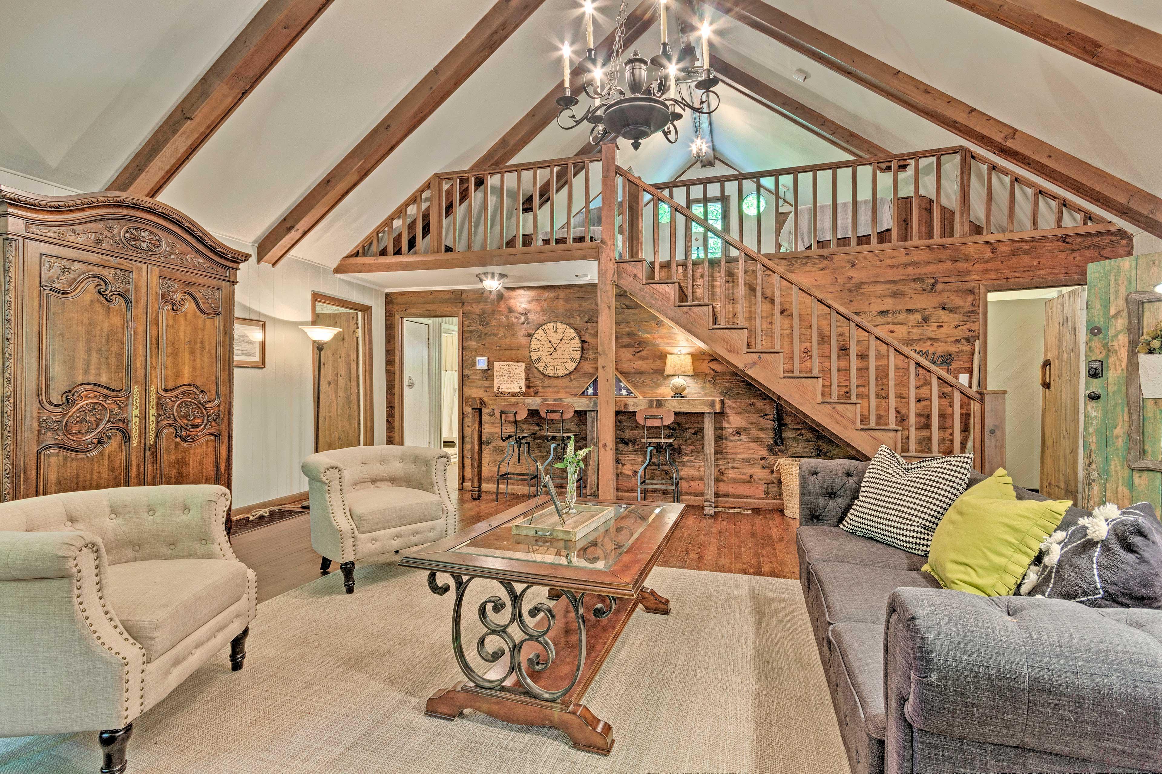 The open layout boasts hardwood floors and a loft!
