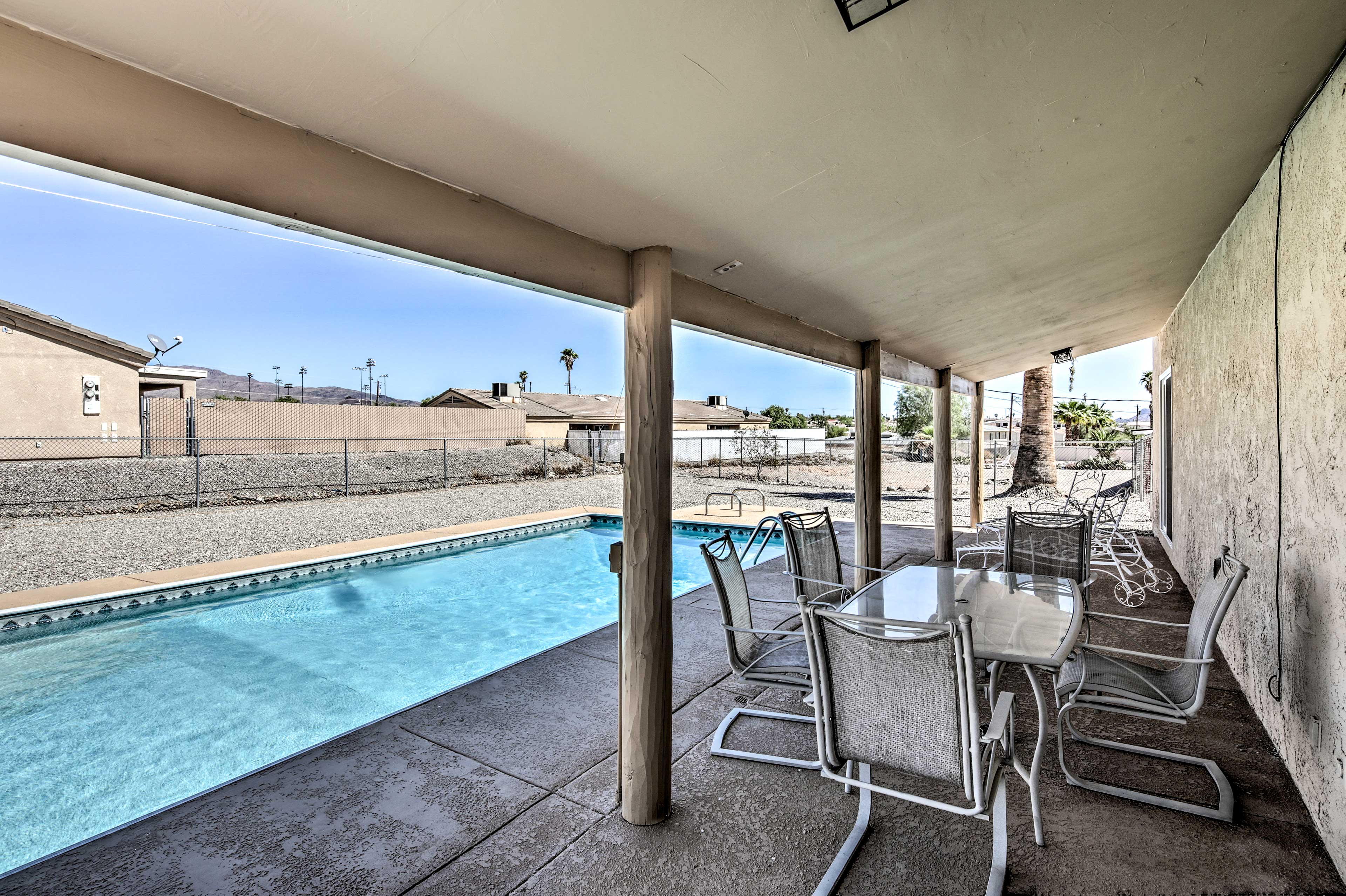 This house boasts a private pool and plenty of backyard space!