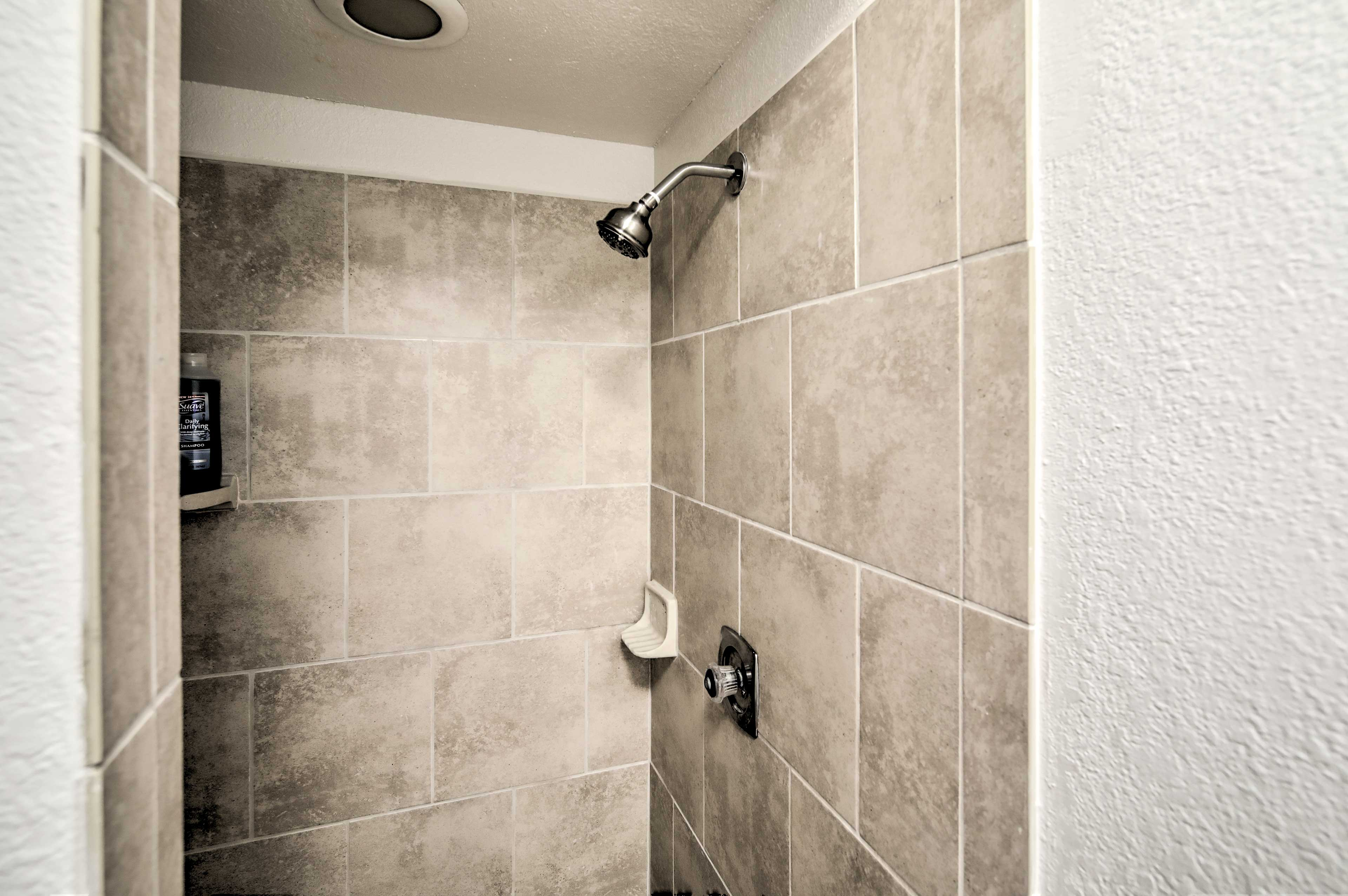 This bathroom features a walk-in shower.